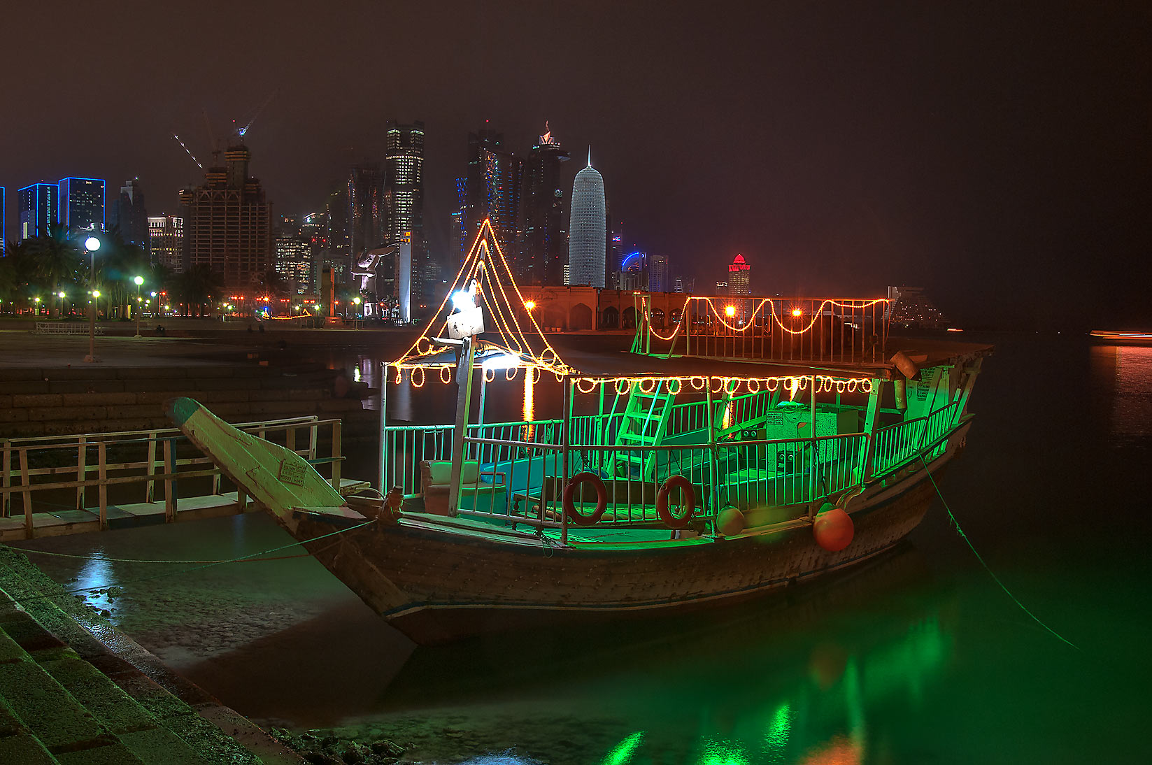 Dhow boat with West Bay in background from Corniche promenade. Doha, Qatar