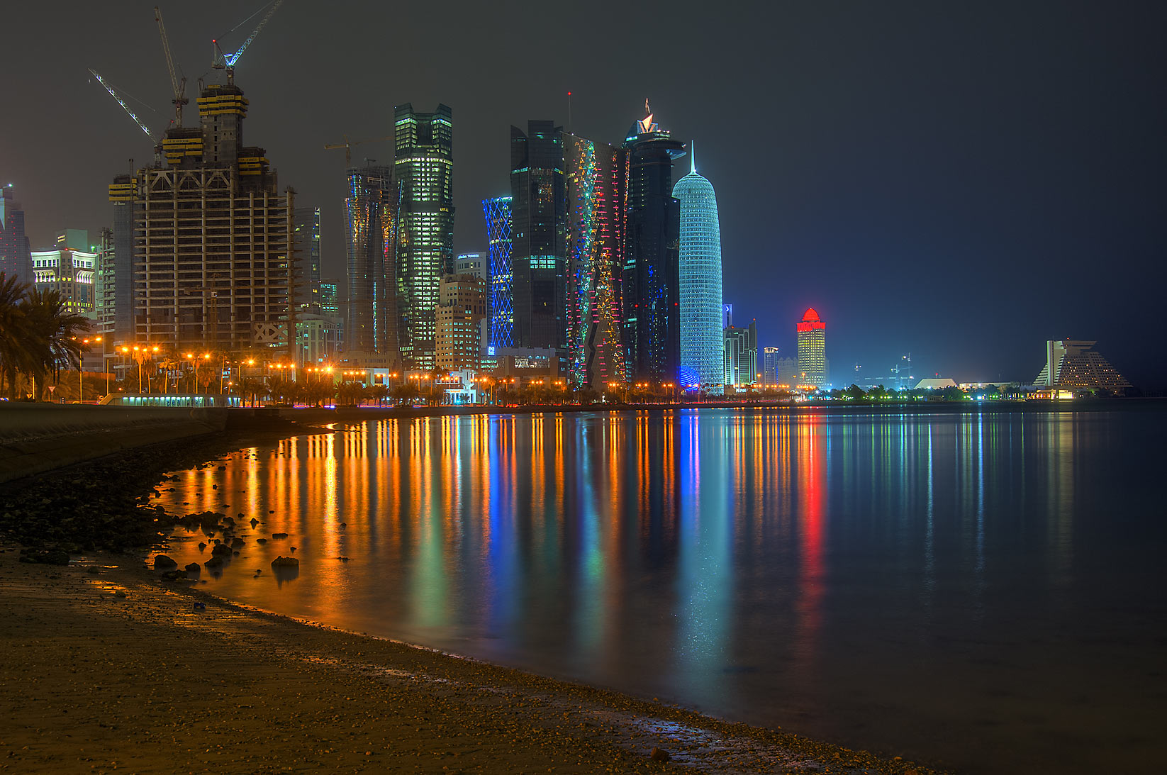 View of West Bay from Corniche promenade at low tide. Doha, Qatar