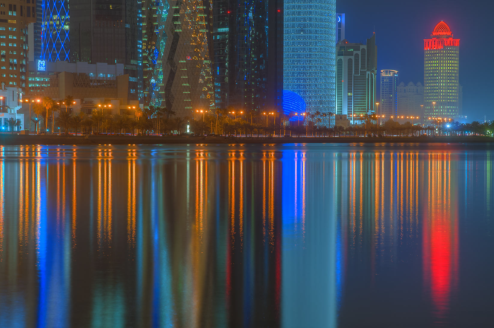 Reflections of West Bay from Corniche promenade at low tide. Doha, Qatar