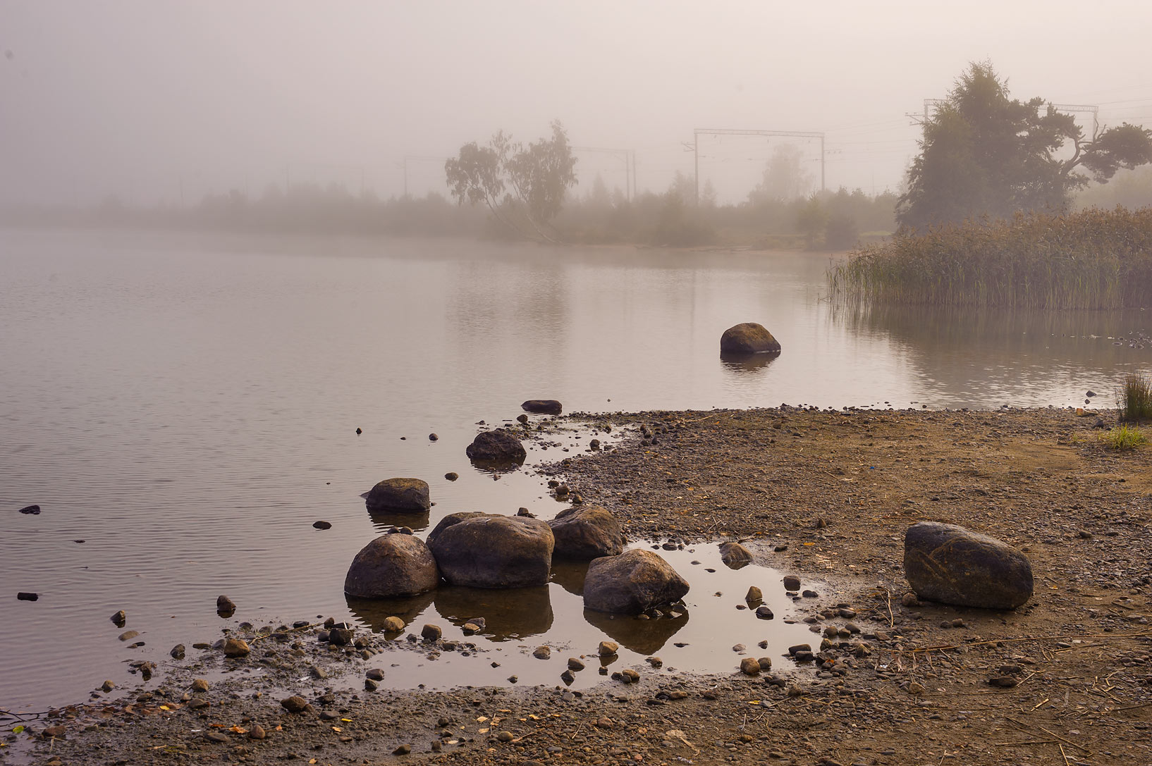 Beach of Kavgolovskoe Lake in fog. Kavgolovo, a suburb of St.Petersburg, Russia