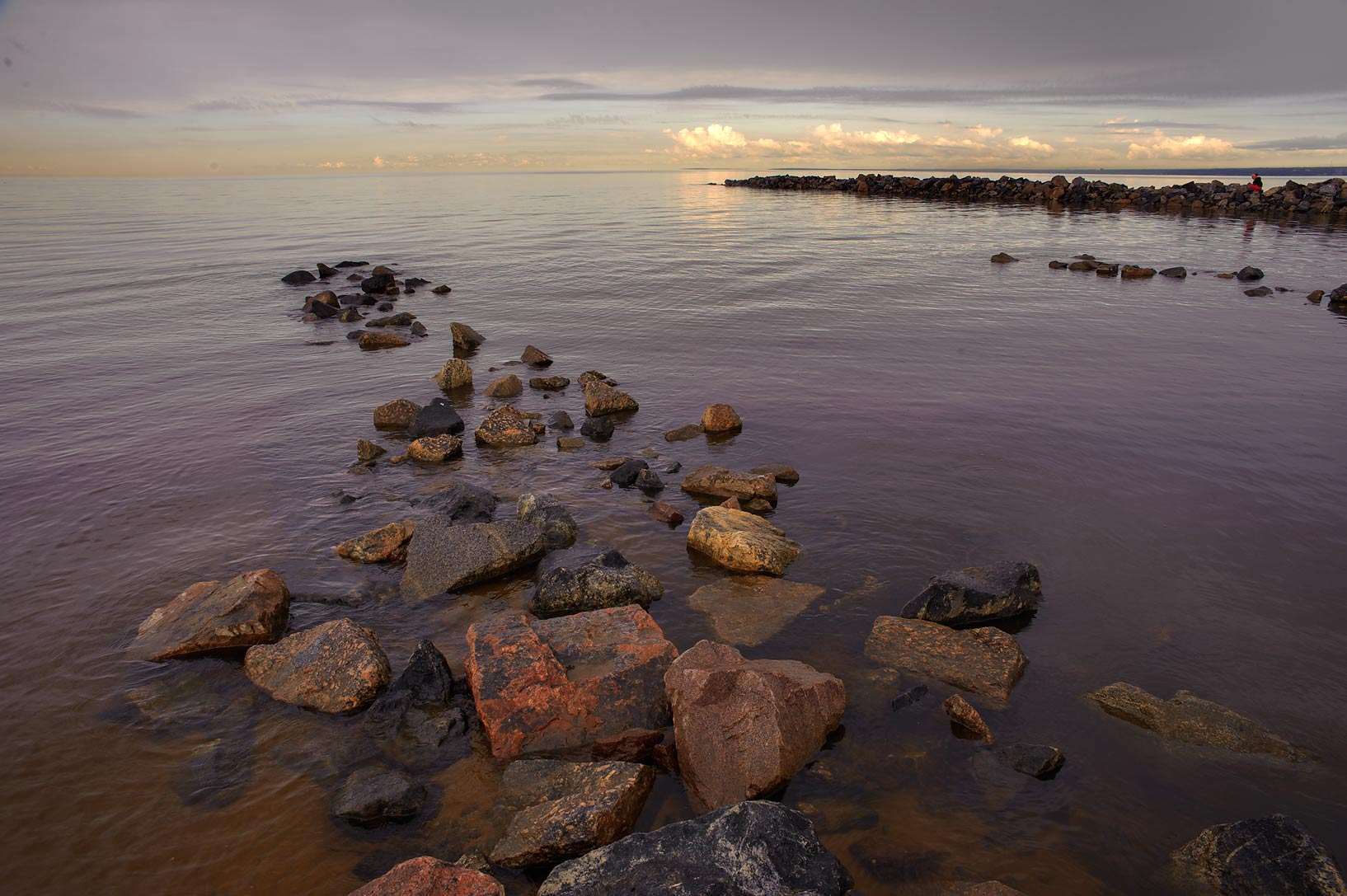 Stone pier in still weather in Gulf of Finland...west from St.Petersburg. Russia