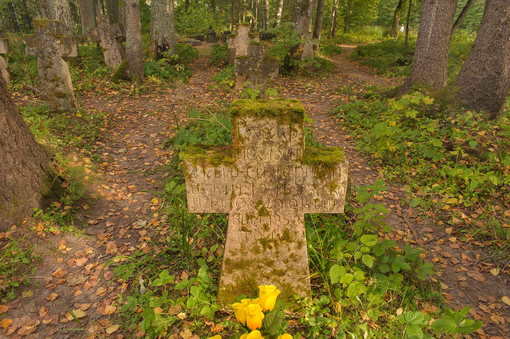 Tomb of a monk in cemetery of Holy Annunciation...Pustyn). Pskov Region, Russia
