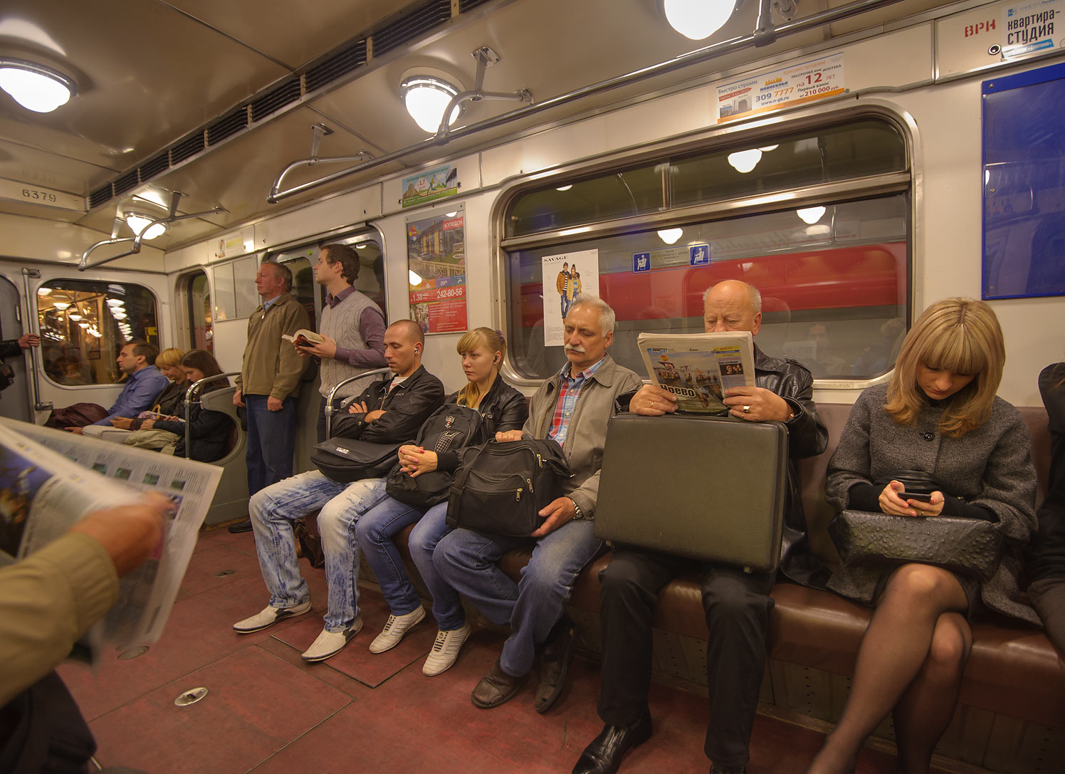 Passengers reading in a carriage of subway (Metro). St.Petersburg, Russia