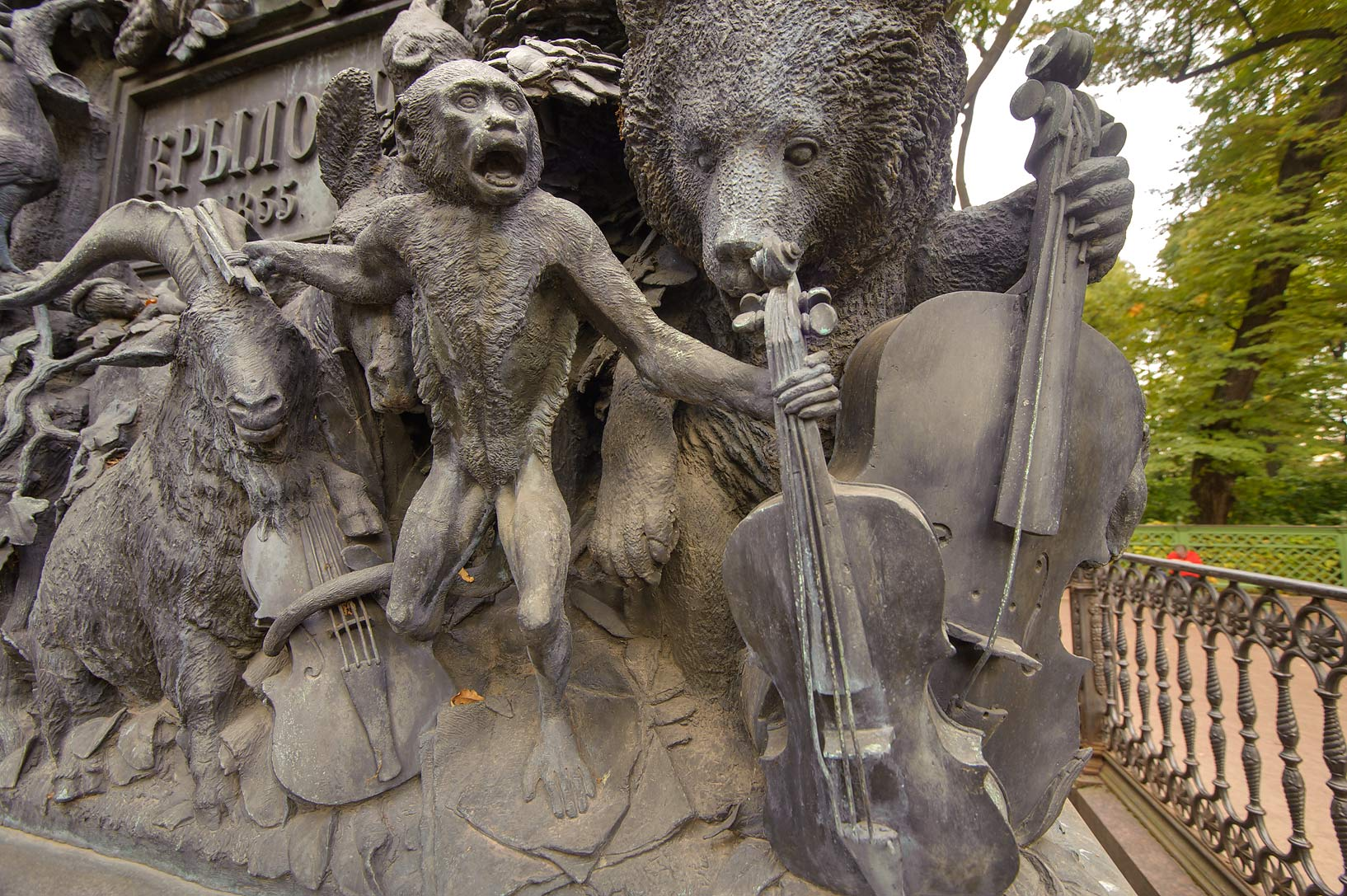 Monkey on a monument of Russian fabulist Ivan...Summer Garden). St.Petersburg, Russia