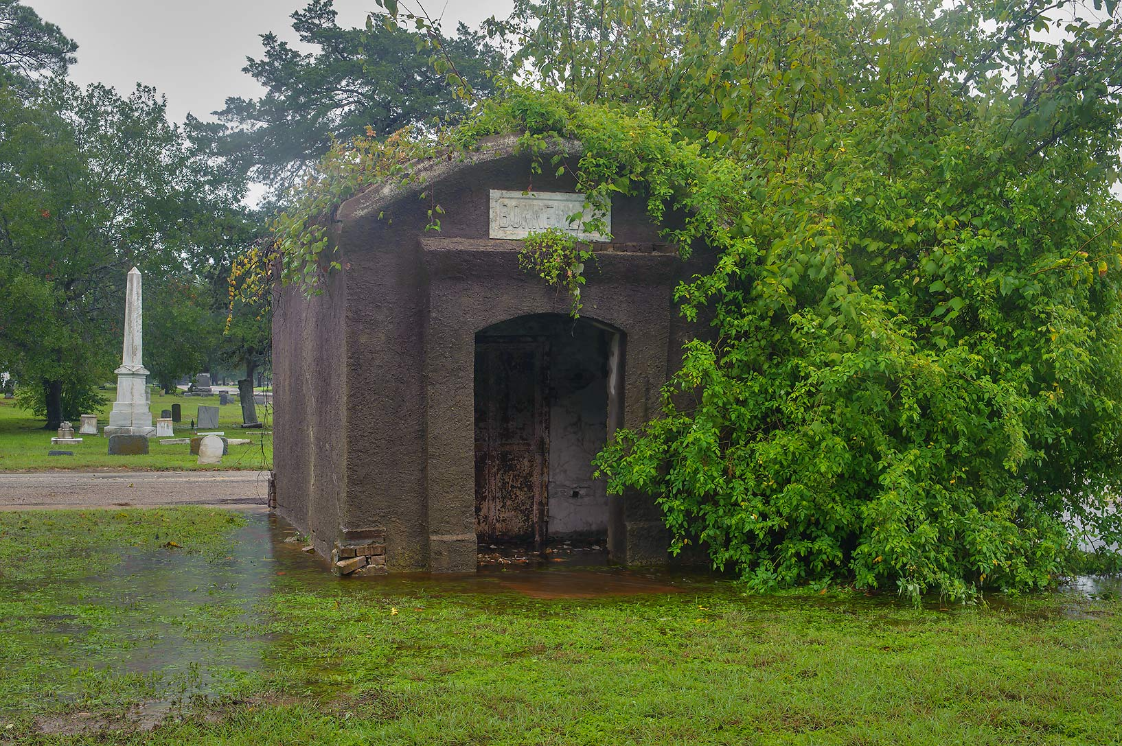 A crypt in City Cemetery at rain. Bryan, Texas