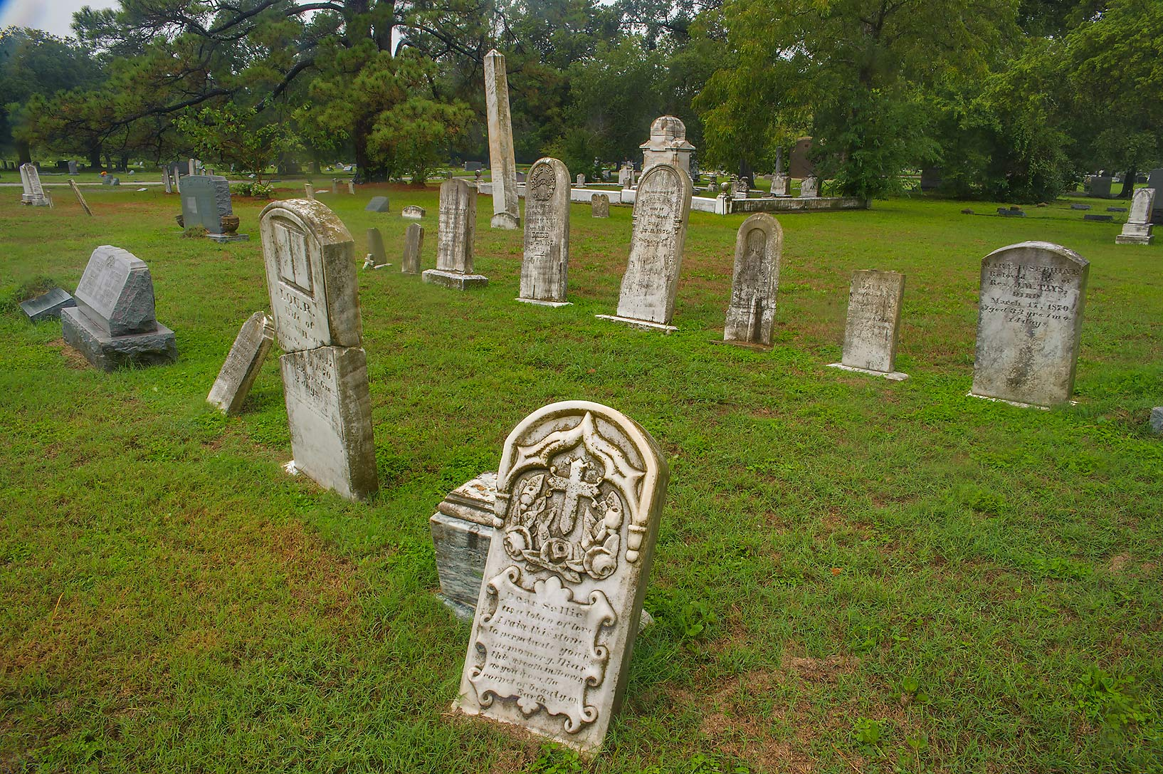 Marble tombstones in City Cemetery at rain. Bryan, Texas