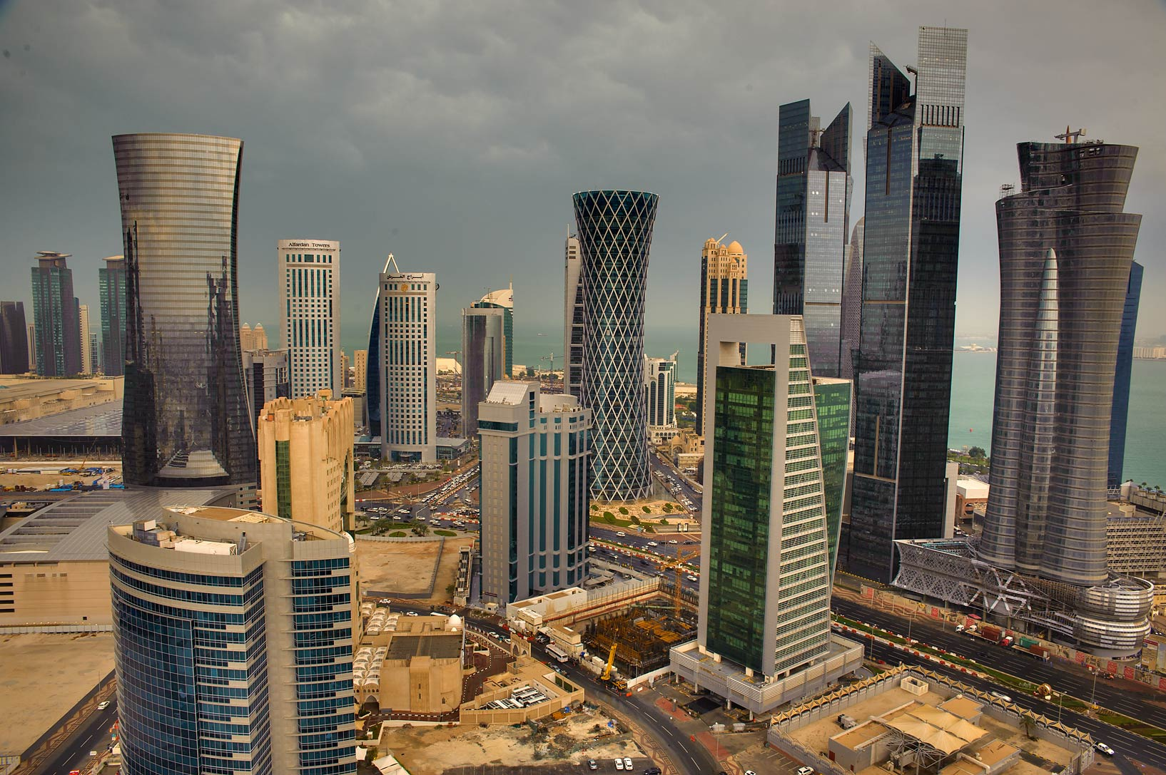 Business area of West Bay from a gym hall on 30...Dareen Tower after a rain. Doha, Qatar