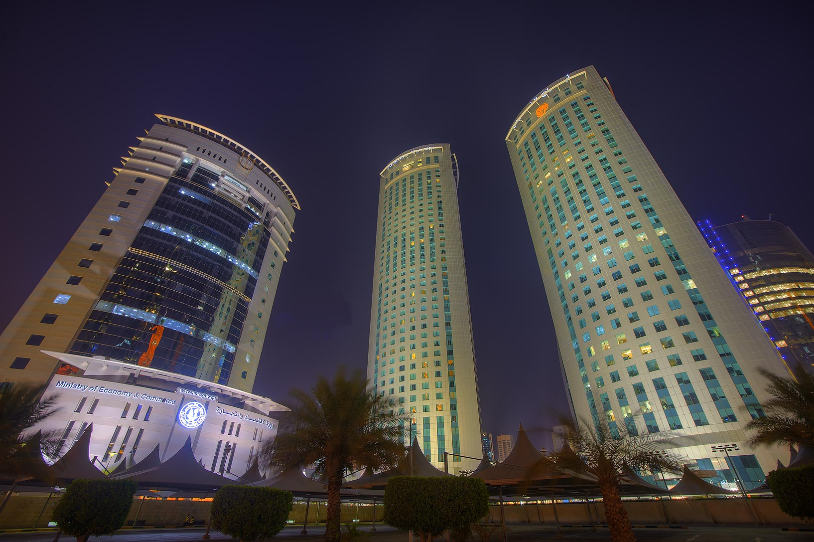 Ministry of Economy and Commerce and Al Fardan...in West Bay at evening. Doha, Qatar