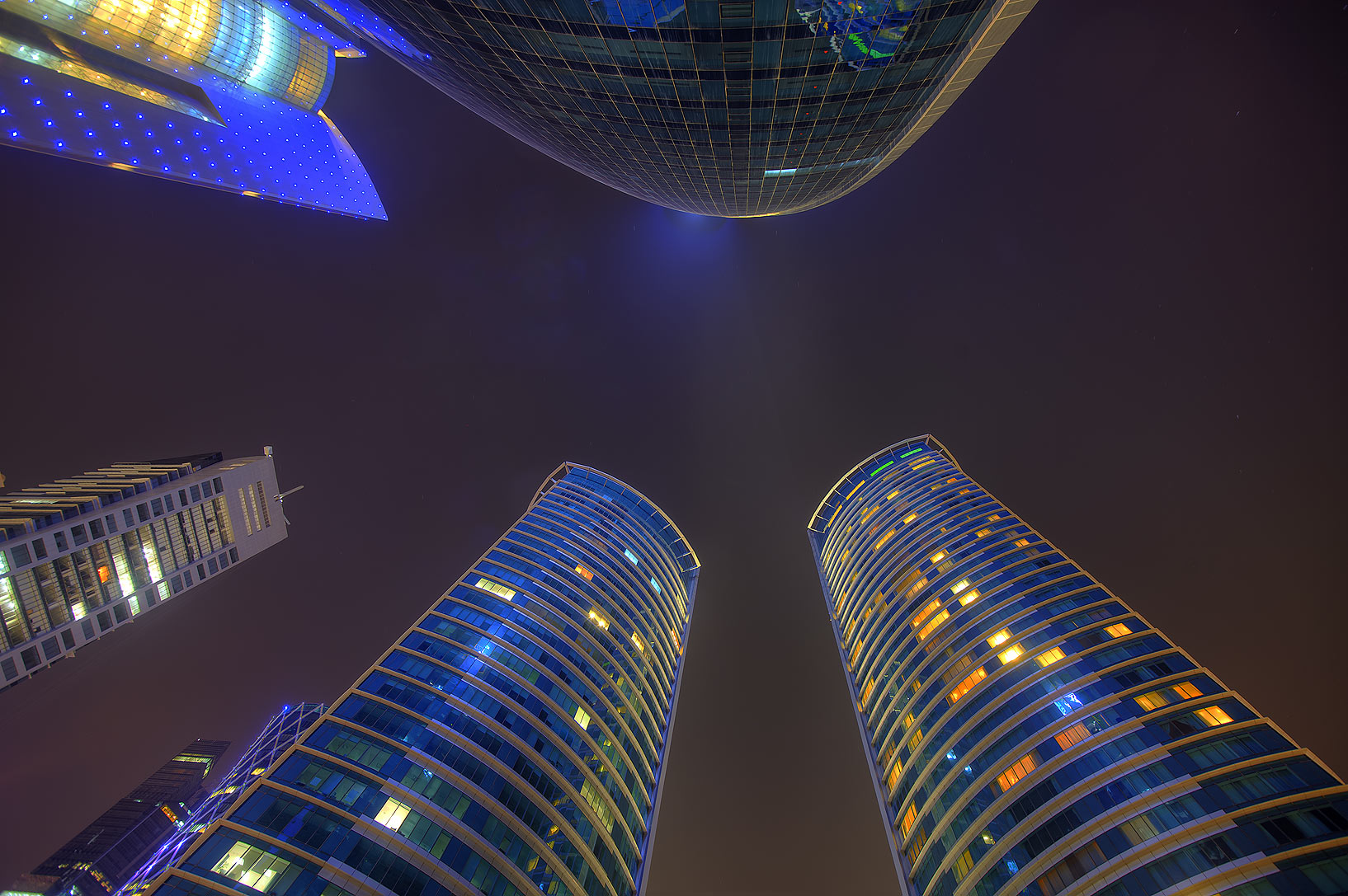 Woqod and Al Fardan Twin towers in West Bay, looking up. Doha, Qatar