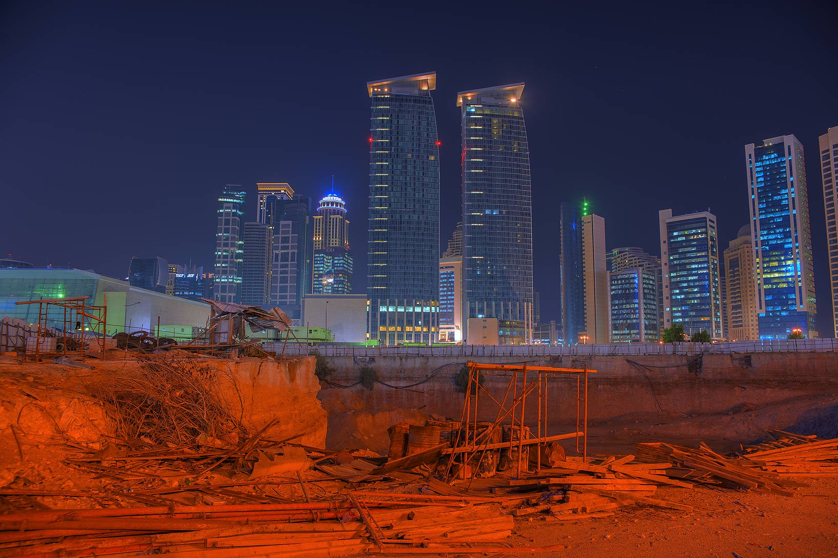 Merweb and Rotana towers behind a pit in West Bay. Doha, Qatar
