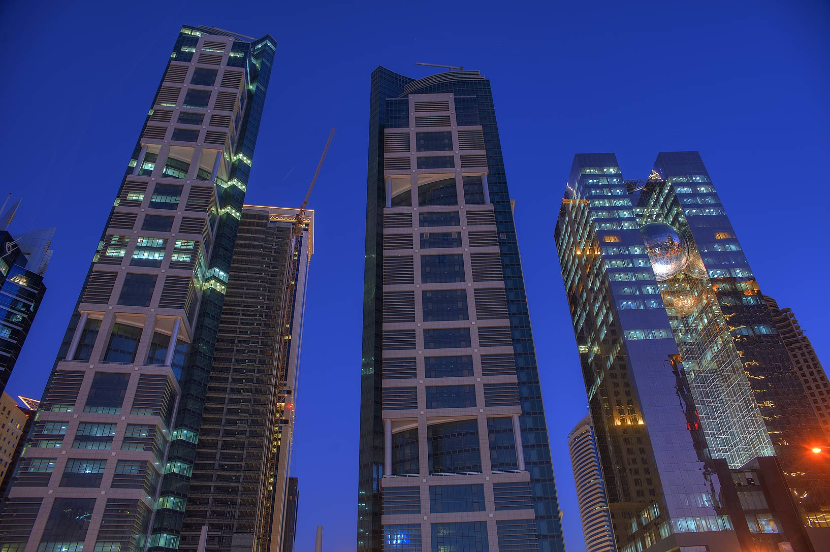 Tall buildings on northern side of Conference Center St. in West Bay. Doha, Qatar