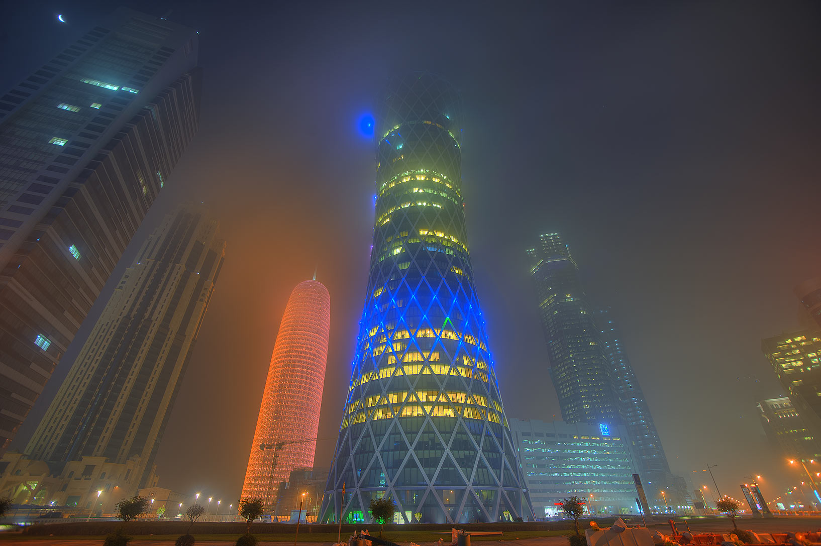 Tornado Tower at crossing of Majlis Al Taawon and...in West Bay in fog. Doha, Qatar
