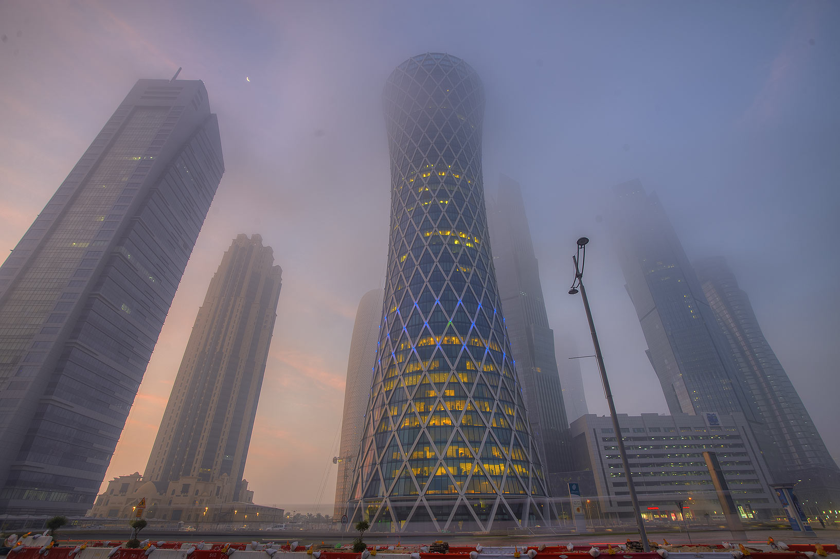 Tornado Tower from crossing of Majlis Al Taawon...in West Bay in fog. Doha, Qatar
