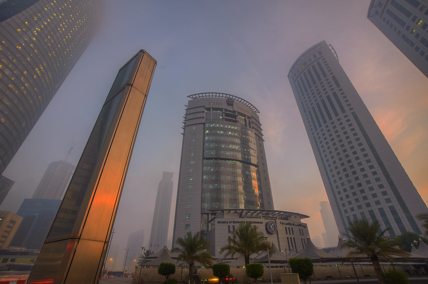 Crossing of Majlis Al Taawon and Al Funduq streets in West Bay in fog. Doha, Qatar