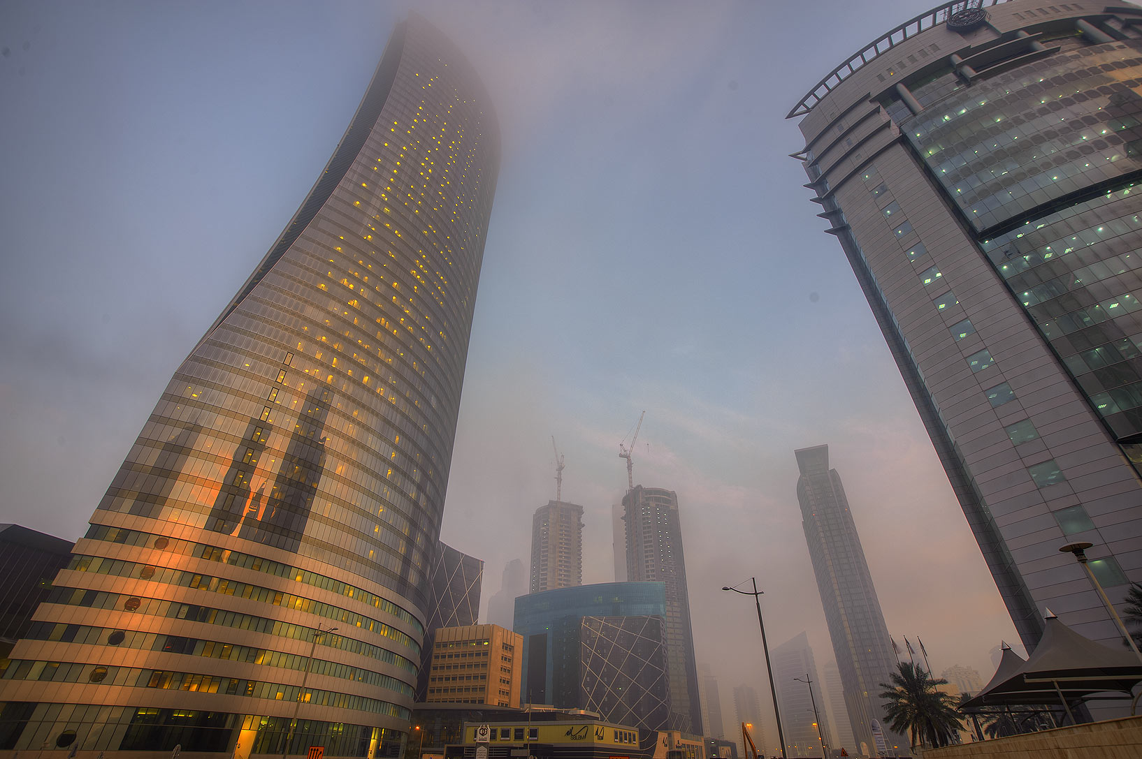 Navigation Tower from crossing of Majlis Al...in West Bay in fog. Doha, Qatar
