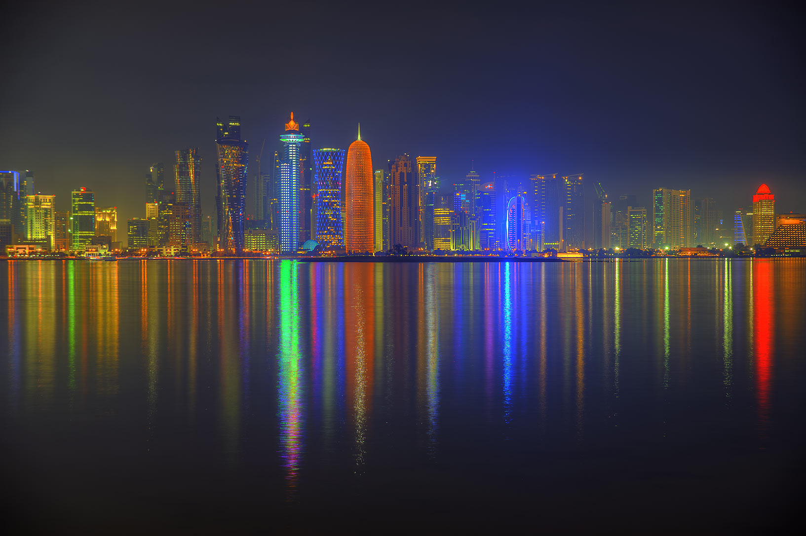 Lights of West Bay from Corniche promenade at evening. Doha, Qatar