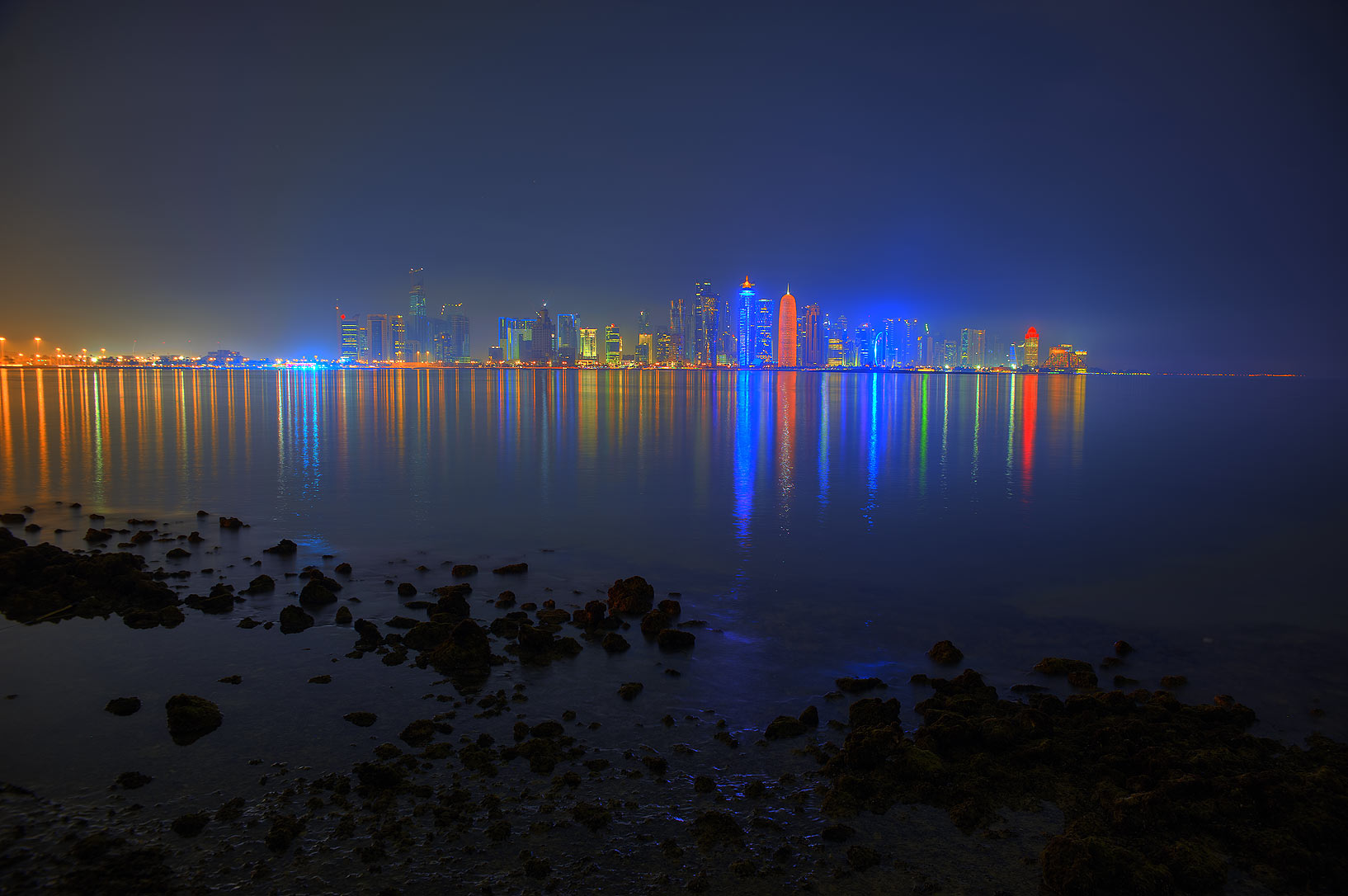 City lights from Corniche promenade at evening. Doha, Qatar