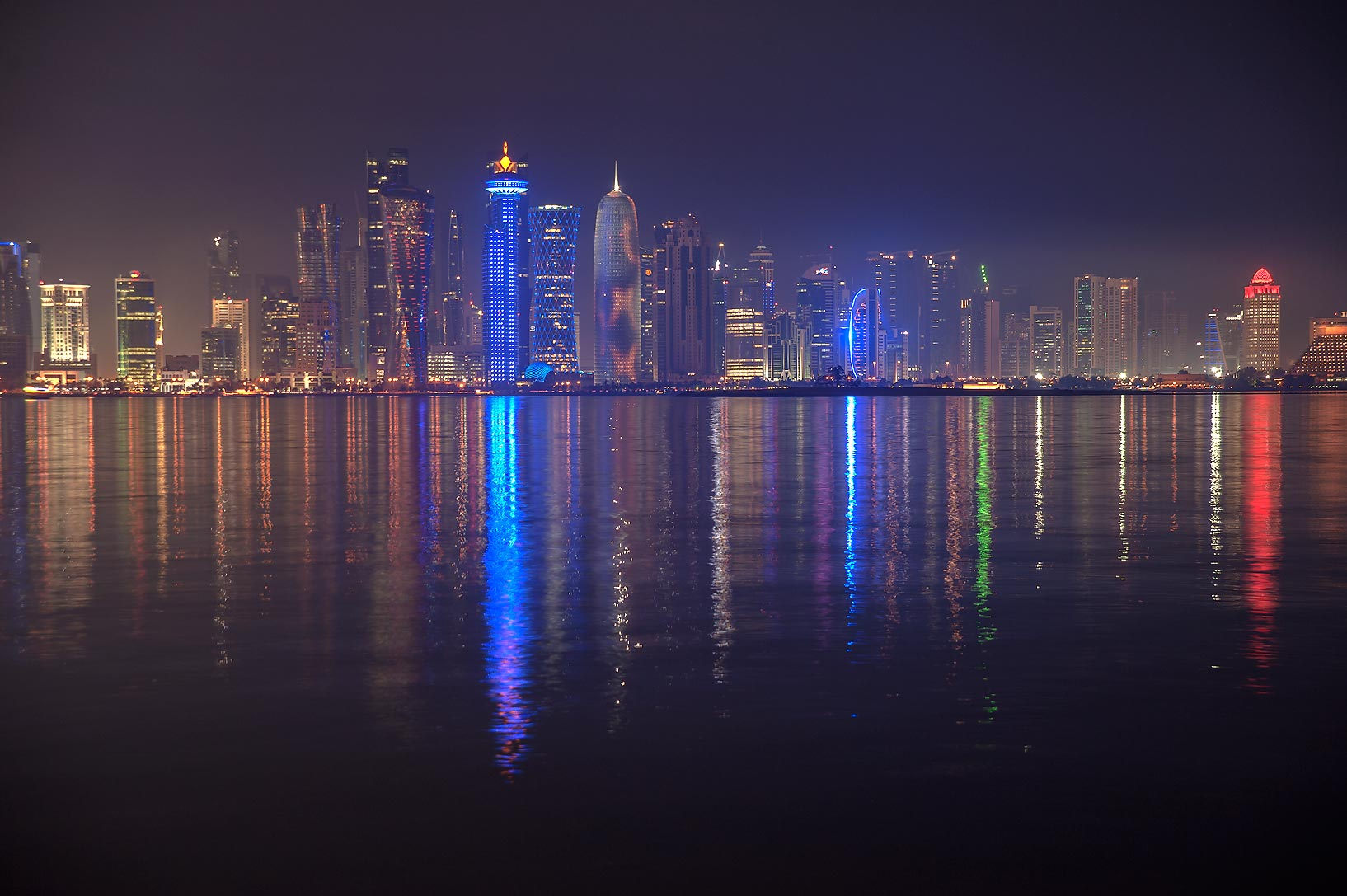 Reflections of West Bay from Corniche promenade at evening. Doha, Qatar