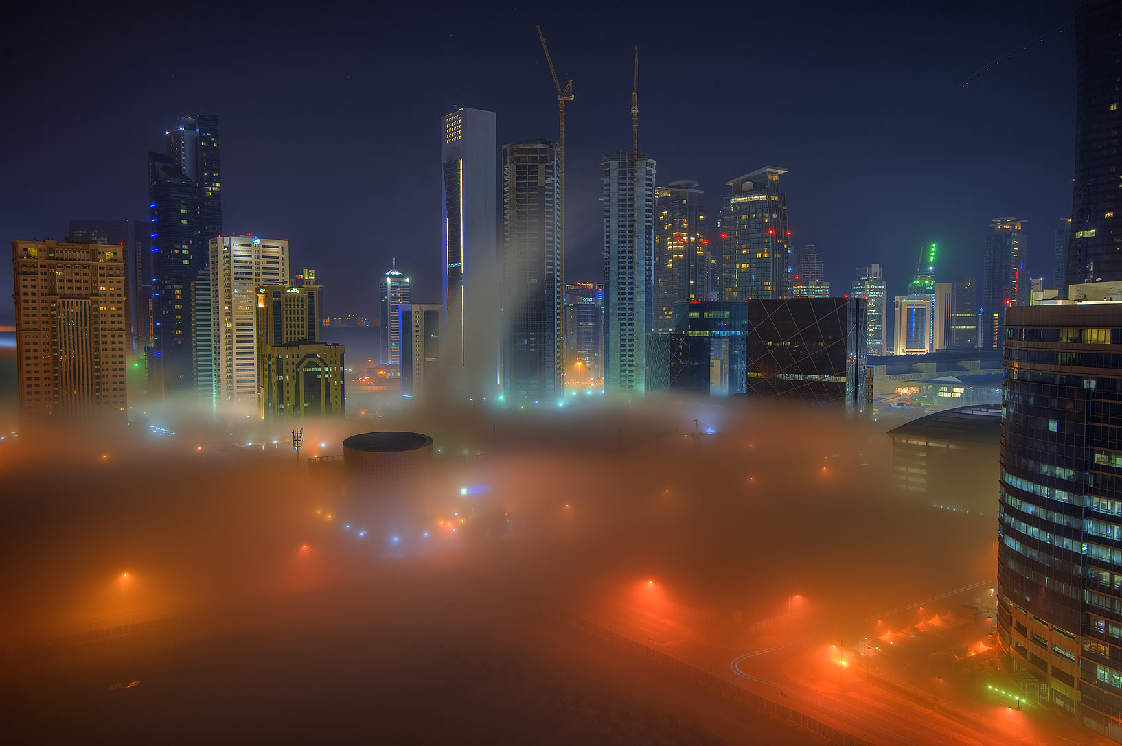 Ground fog in West Bay from Room 1604 of Dareen Tower. Doha, Qatar