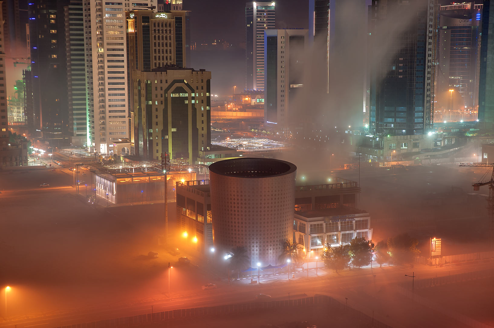 Cooling plant in fog in West Bay from a balcony of Room 1604 of Dareen Tower. Doha, Qatar