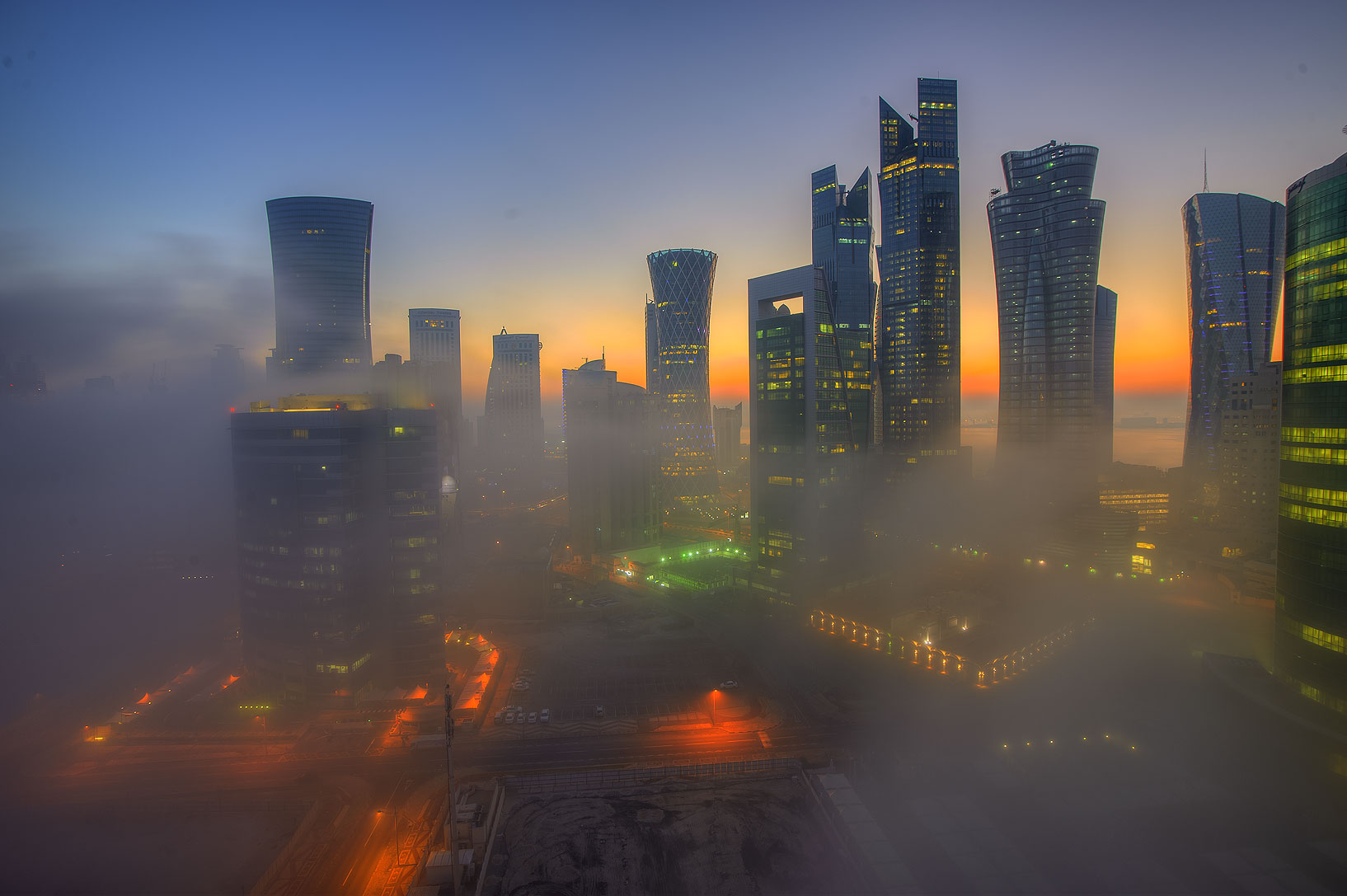 Fog engulfing West Bay to the east from a balcony...Room 1604 of Dareen Tower. Doha, Qatar