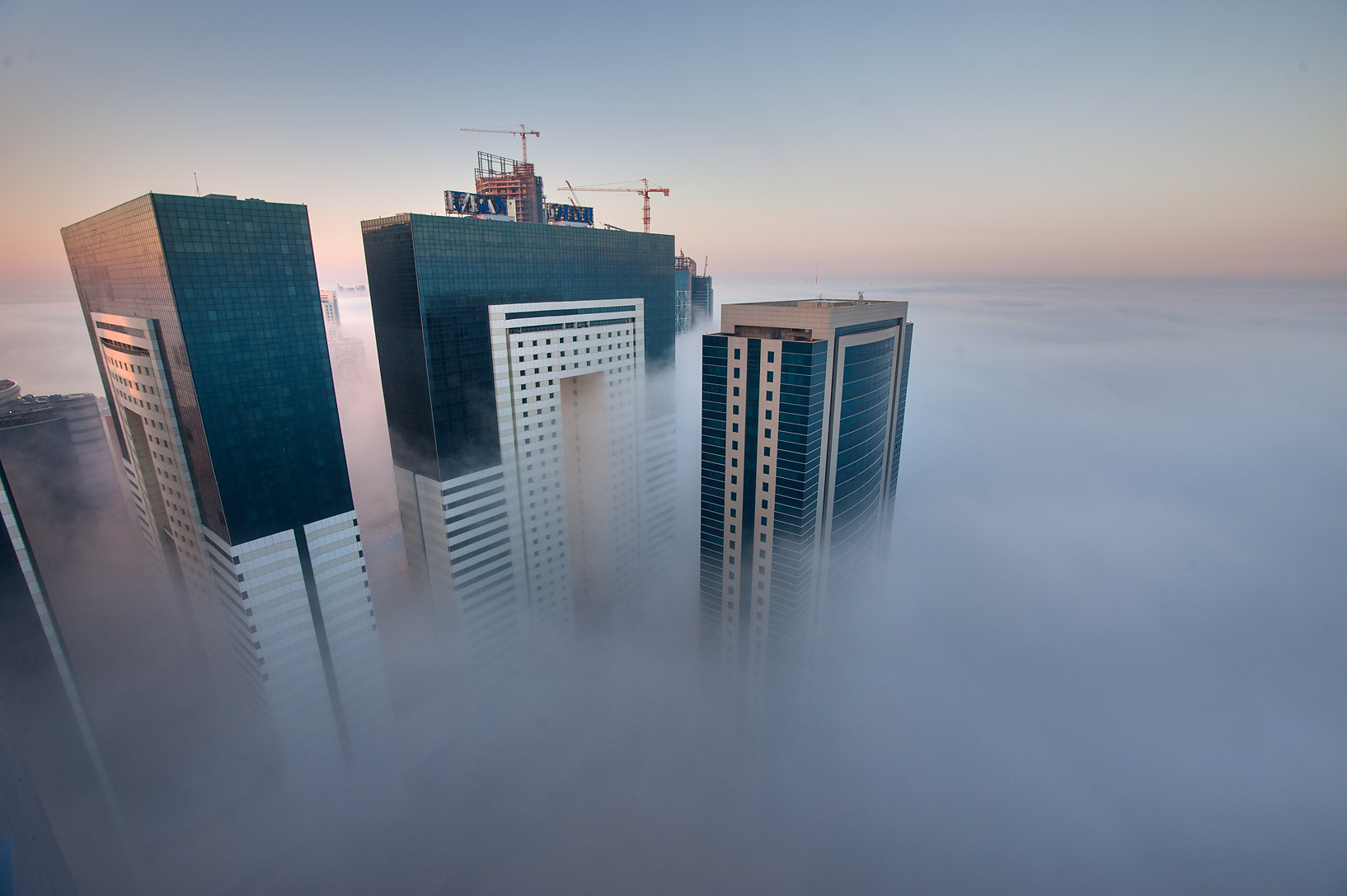 Ezdan Hotel in fog to the east from a balcony of...Dareen Tower in West Bay. Doha, Qatar