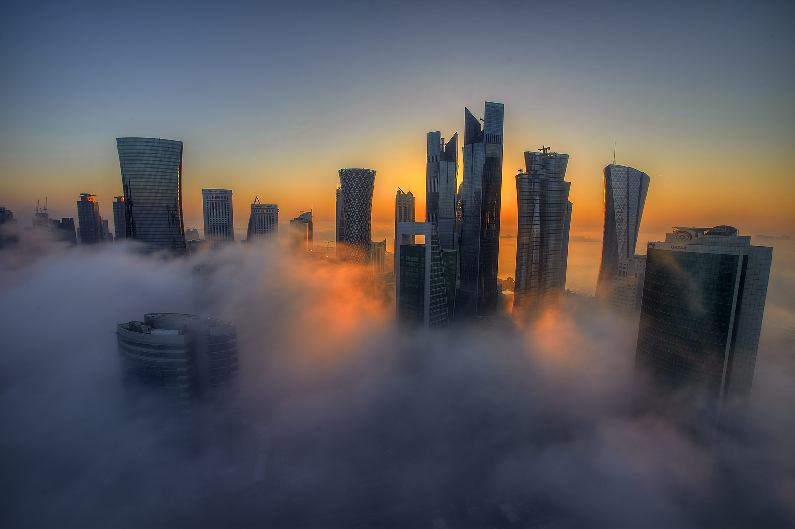 Sunrise in fog to the east from a balcony of Room...Dareen Tower in West Bay. Doha, Qatar