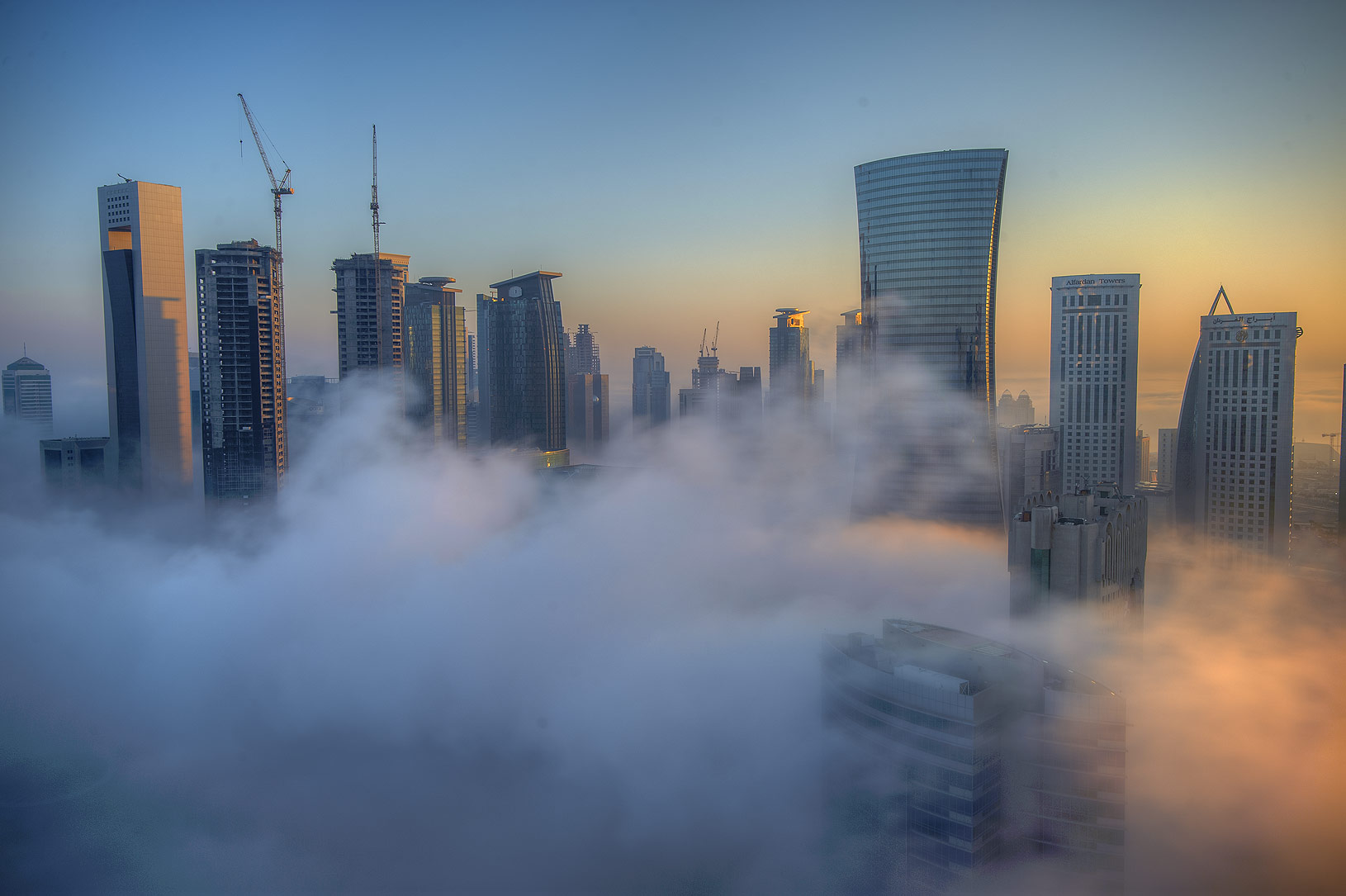 Foggy towers to the east from a balcony of Room...Dareen Tower in West Bay. Doha, Qatar