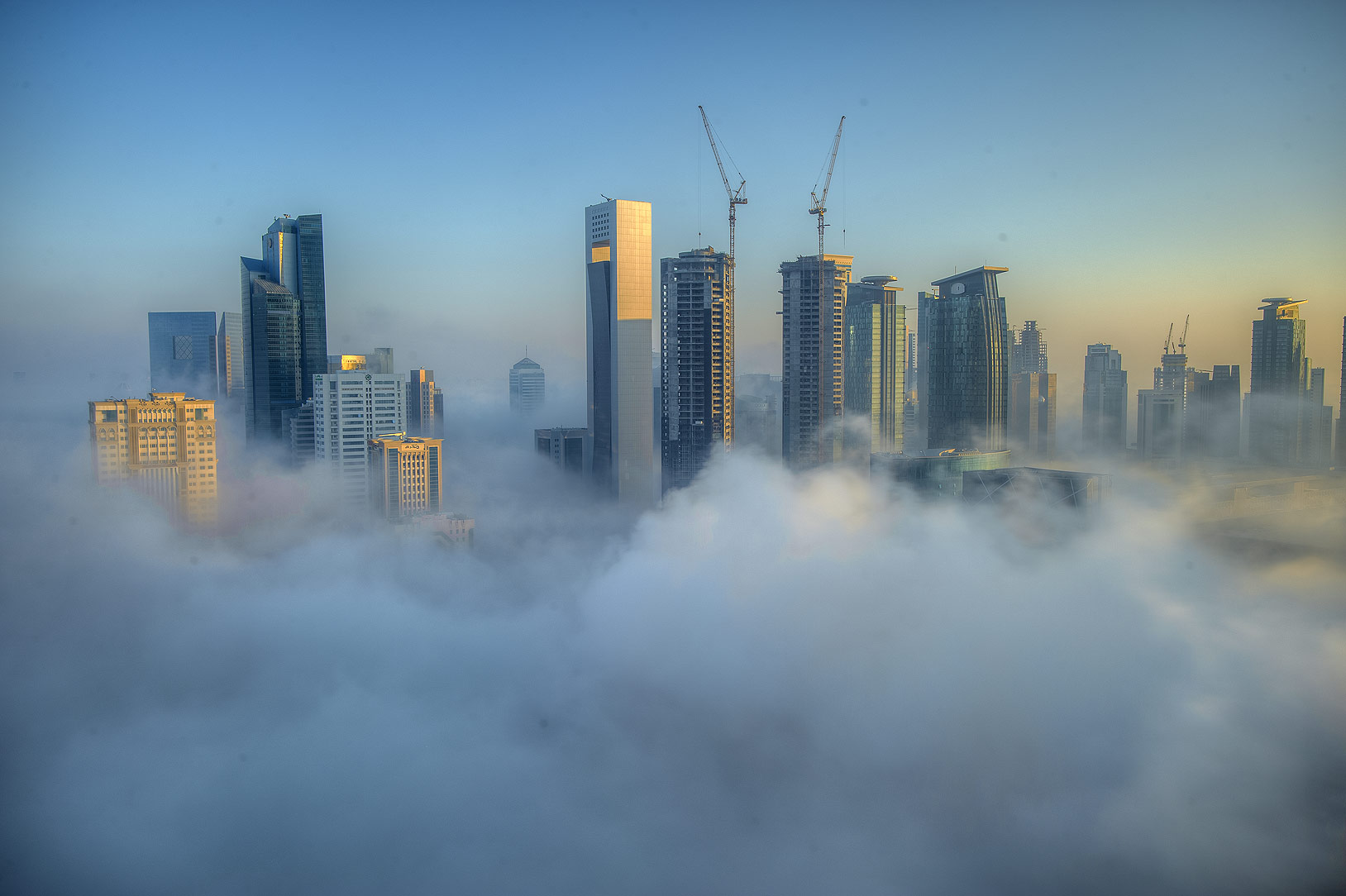 Foggy West Bay to the east from a balcony of Room...Dareen Tower in West Bay. Doha, Qatar
