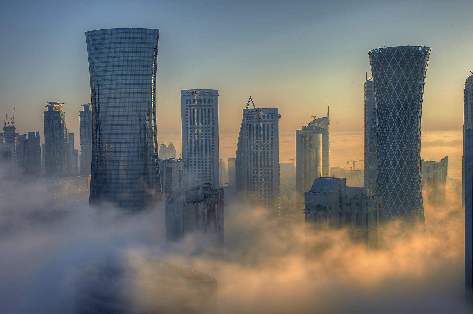Foggy sunrise from a balcony of Room 1604 of Dareen Tower in West Bay. Doha, Qatar
