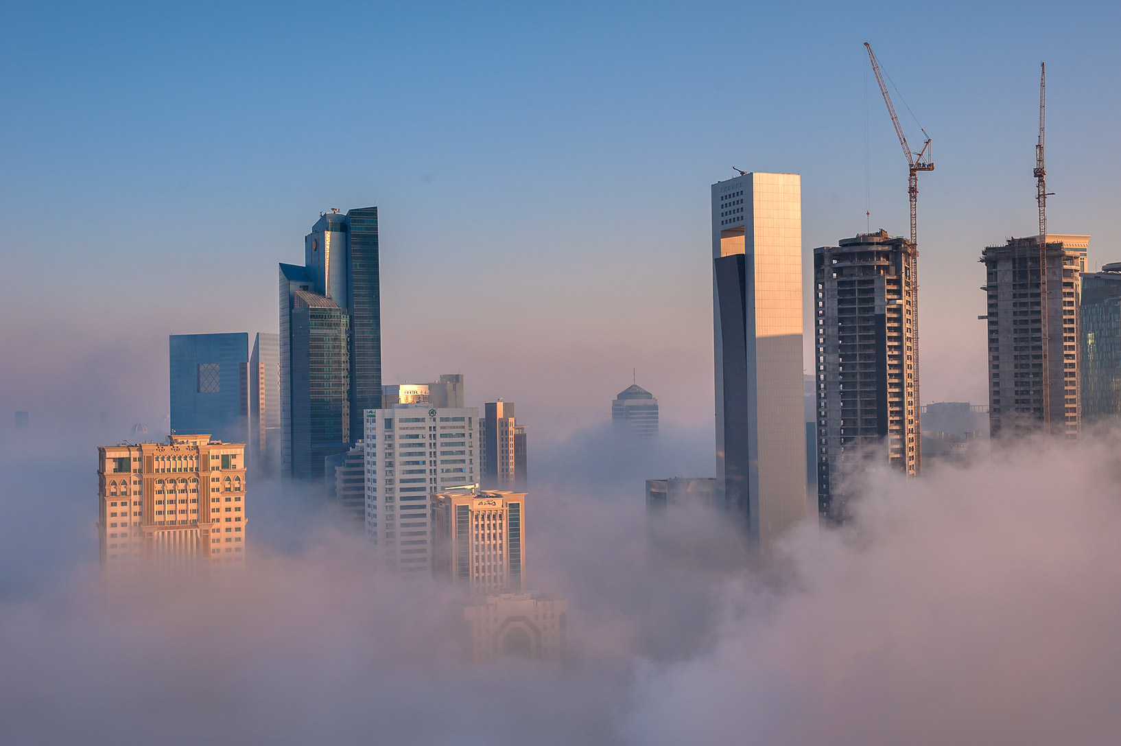 Foggy towers from a balcony of Room 1604 of Dareen Tower in West Bay. Doha, Qatar