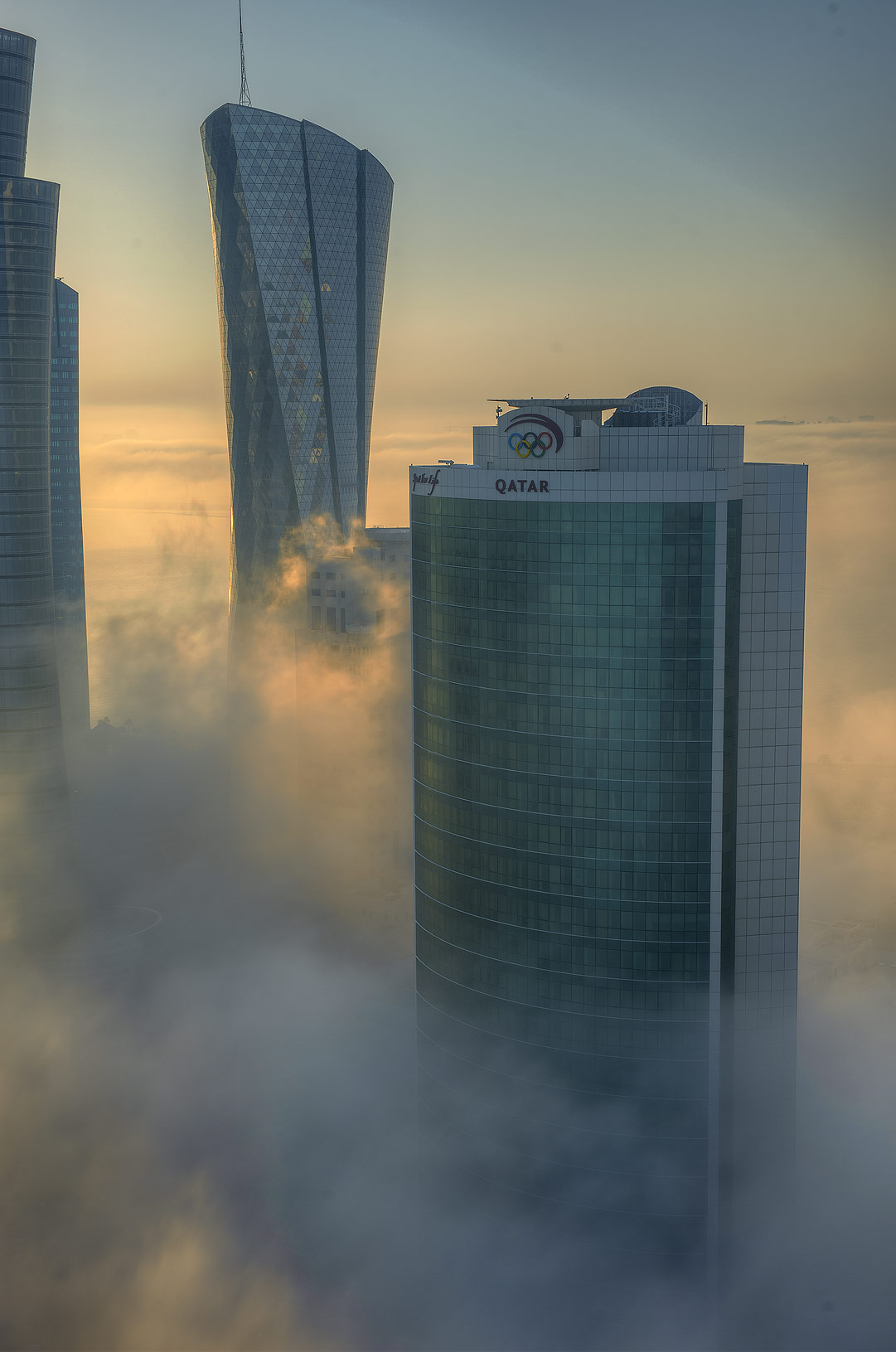 Foggy Al Bidda and Olympic towers from a balcony...Dareen Tower in West Bay. Doha, Qatar