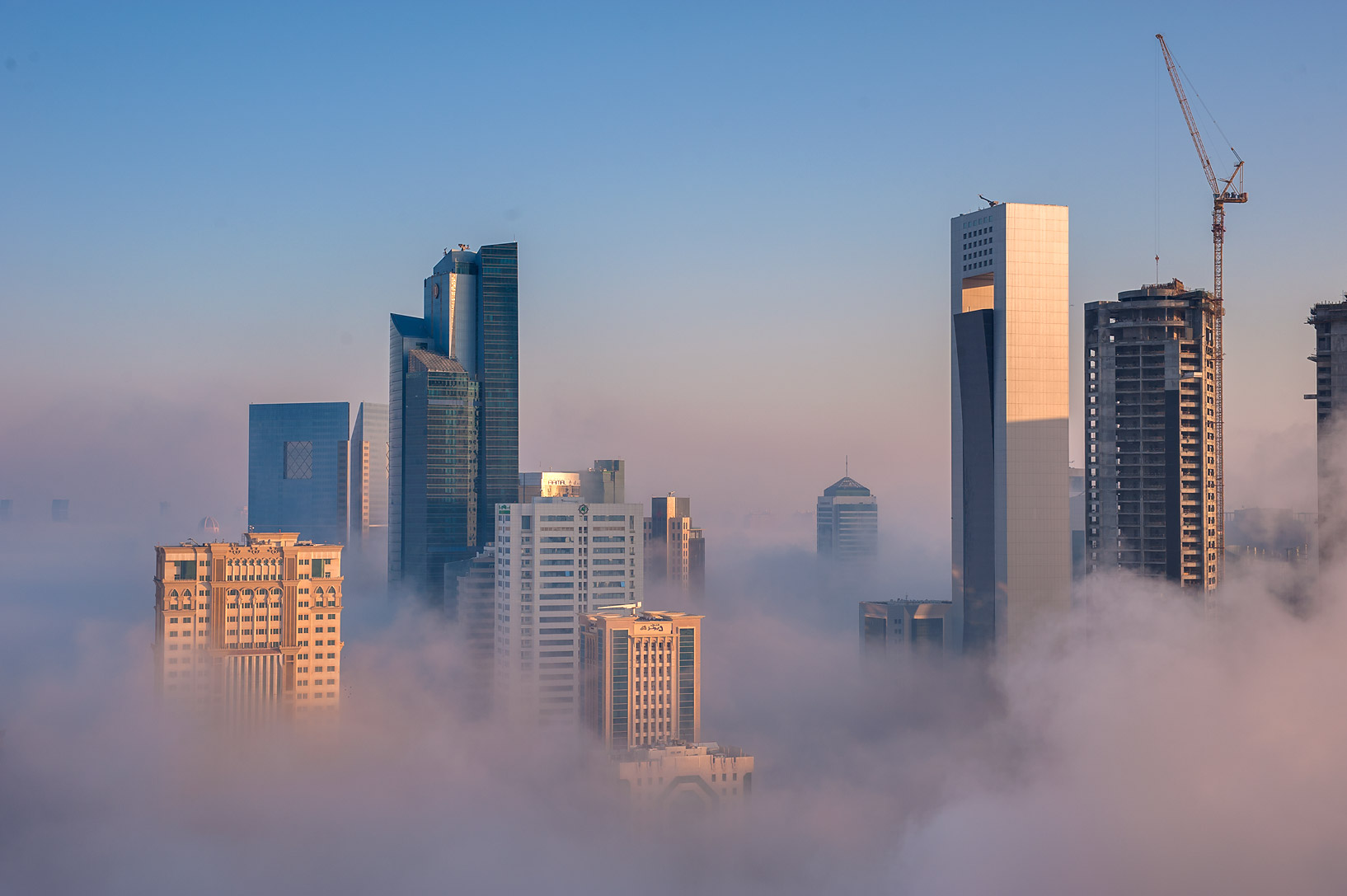 Foggy cityscape from a balcony of Room 1604 of Dareen Tower in West Bay. Doha, Qatar