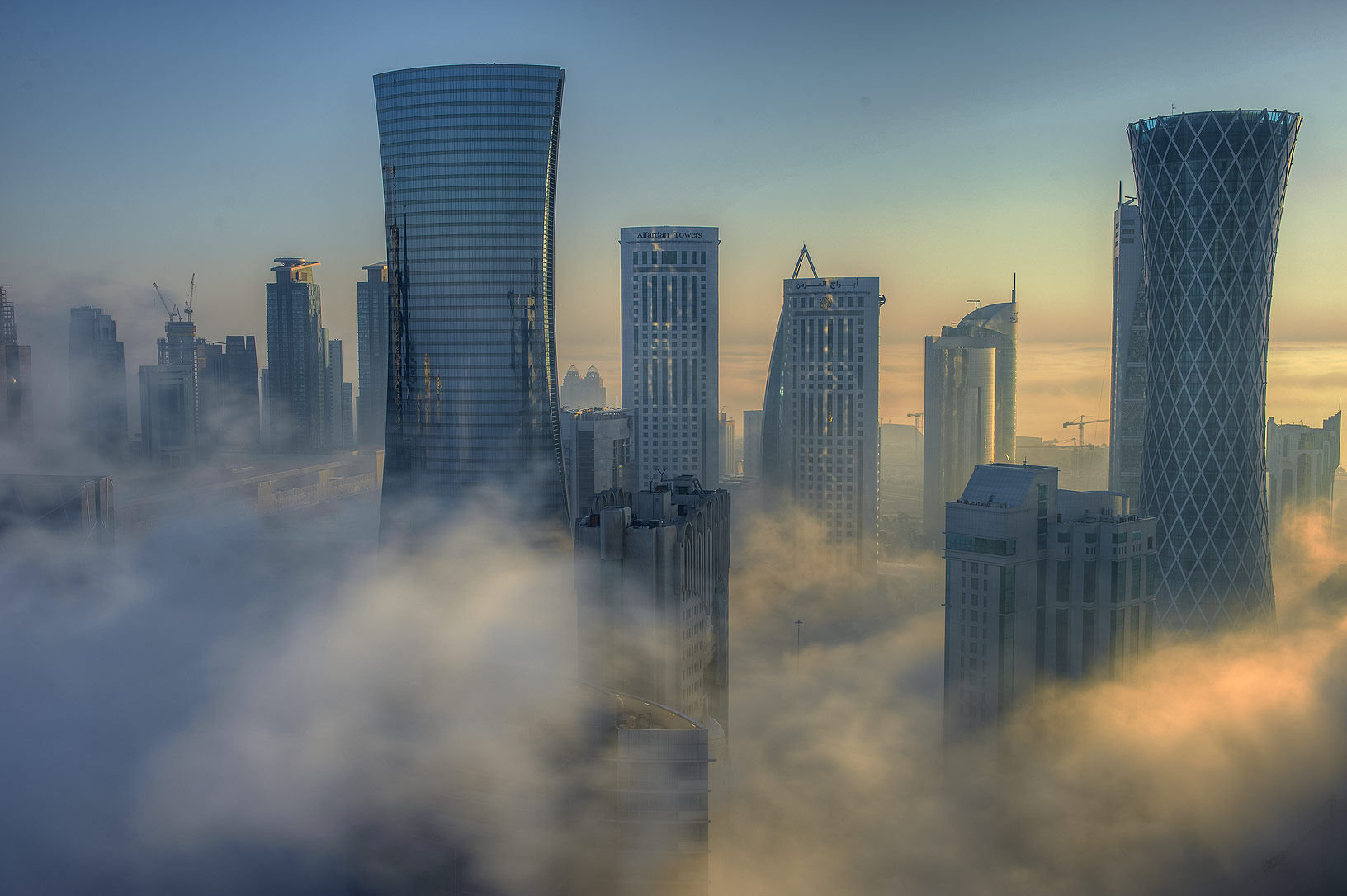 Foggy buildings from a balcony of Room 1604 of Dareen Tower in West Bay. Doha, Qatar