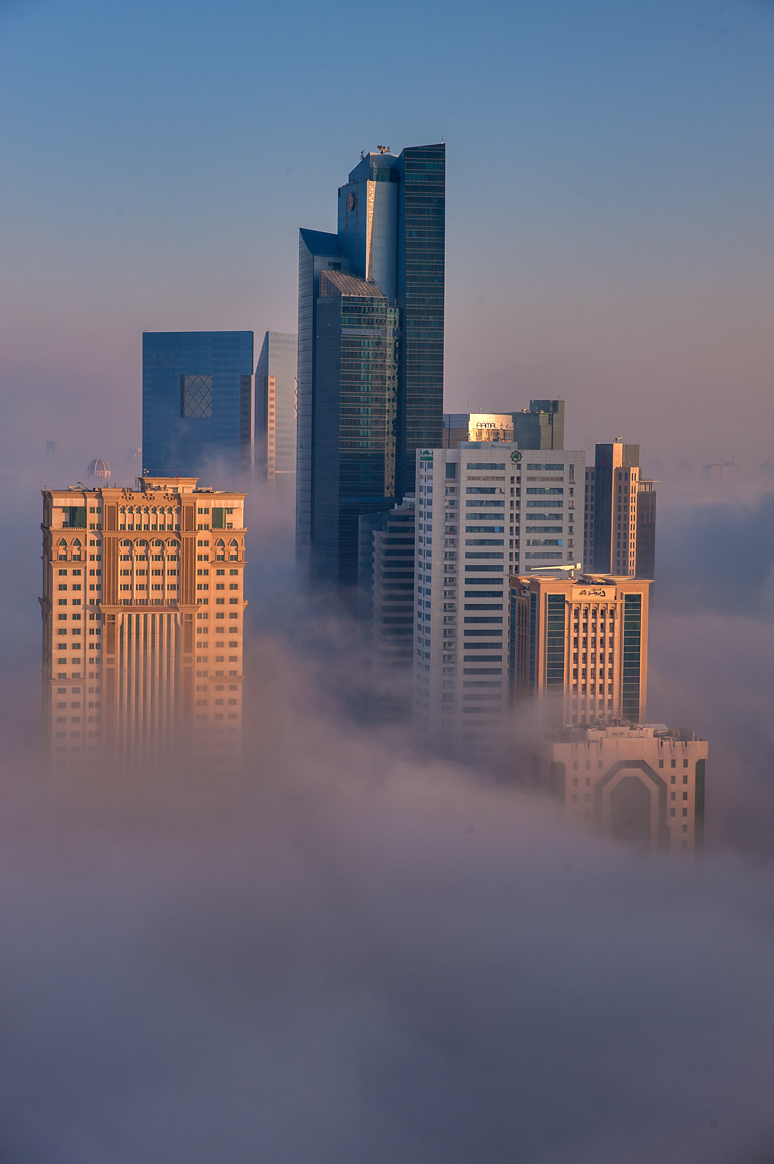 Morning fog engulfed Silhouette Tower from a...Dareen Tower in West Bay. Doha, Qatar