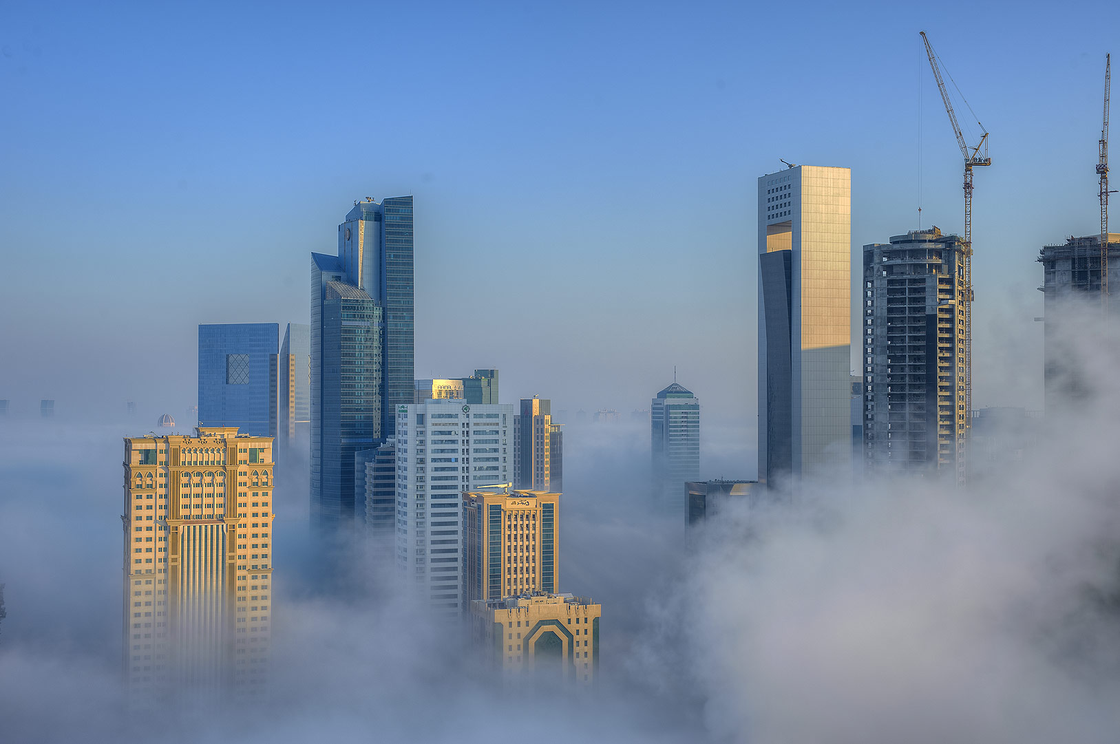 Morning fog engulfed business district from a...Dareen Tower in West Bay. Doha, Qatar