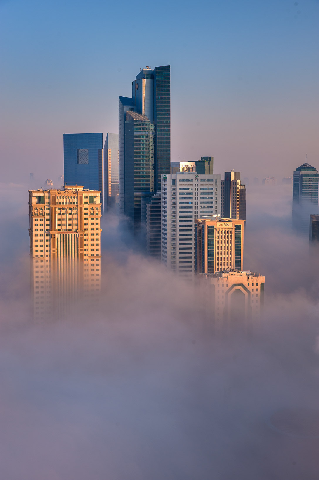 Morning fog engulfed Silhouette Tower in business...Dareen Tower in West Bay. Doha, Qatar