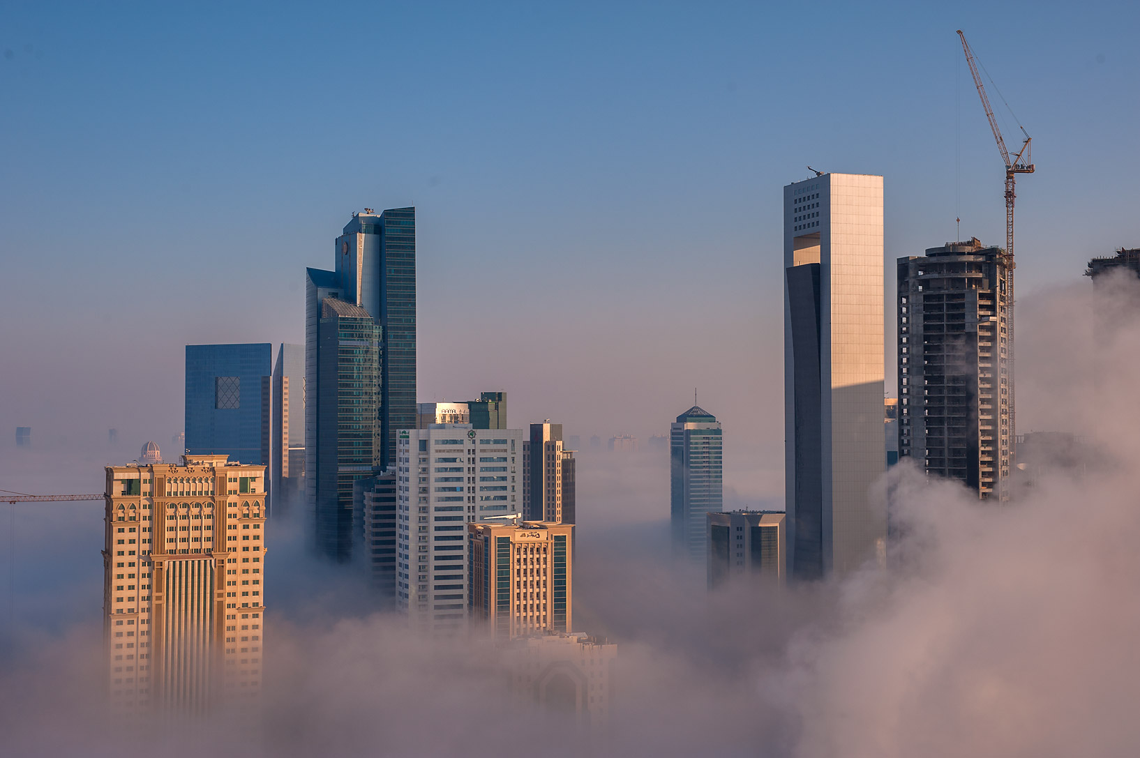 Patchy fog engulfed business district from a...Dareen Tower in West Bay. Doha, Qatar