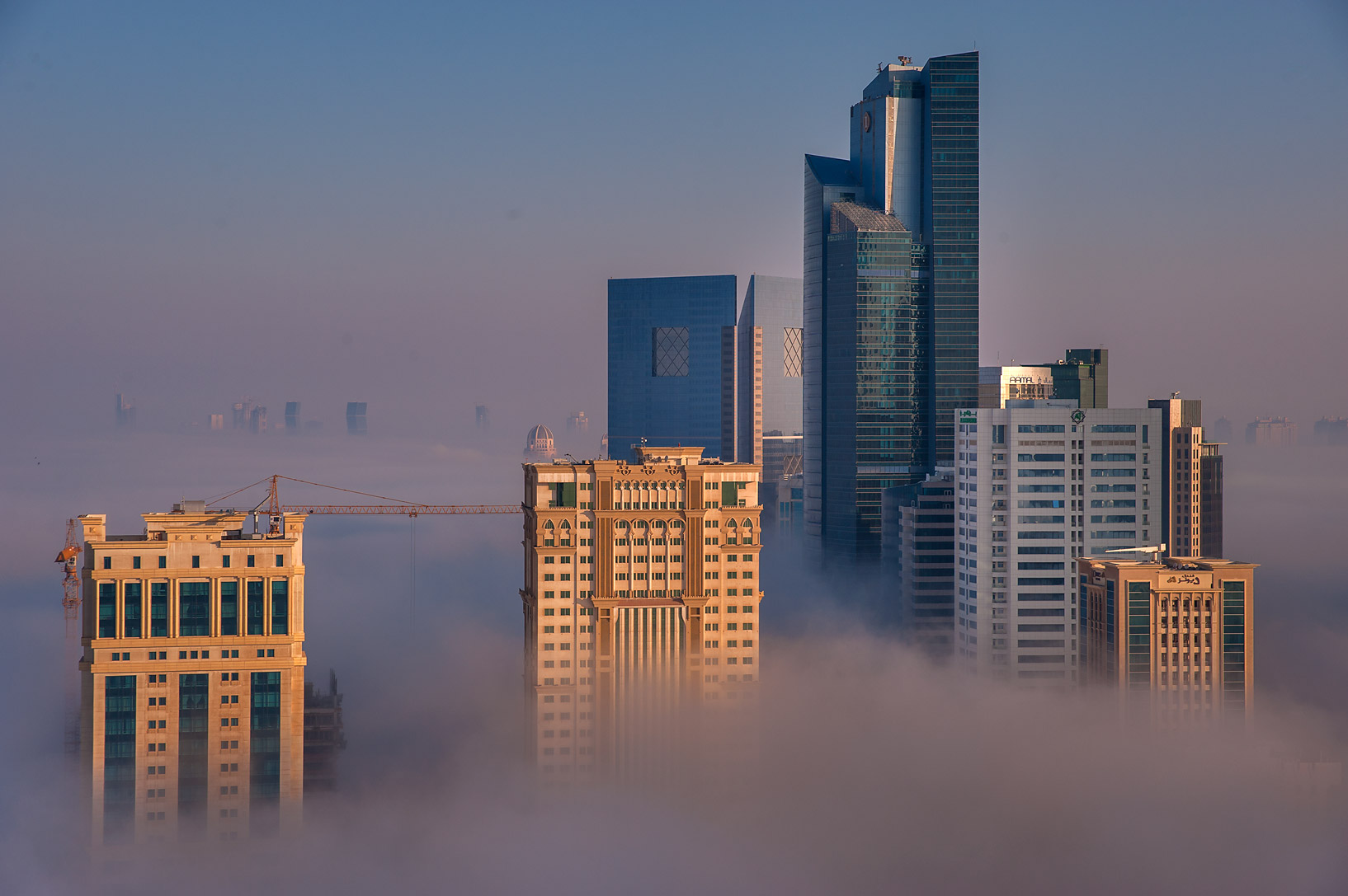 Patchy fog engulfed Silhouette Tower from a...Dareen Tower in West Bay. Doha, Qatar