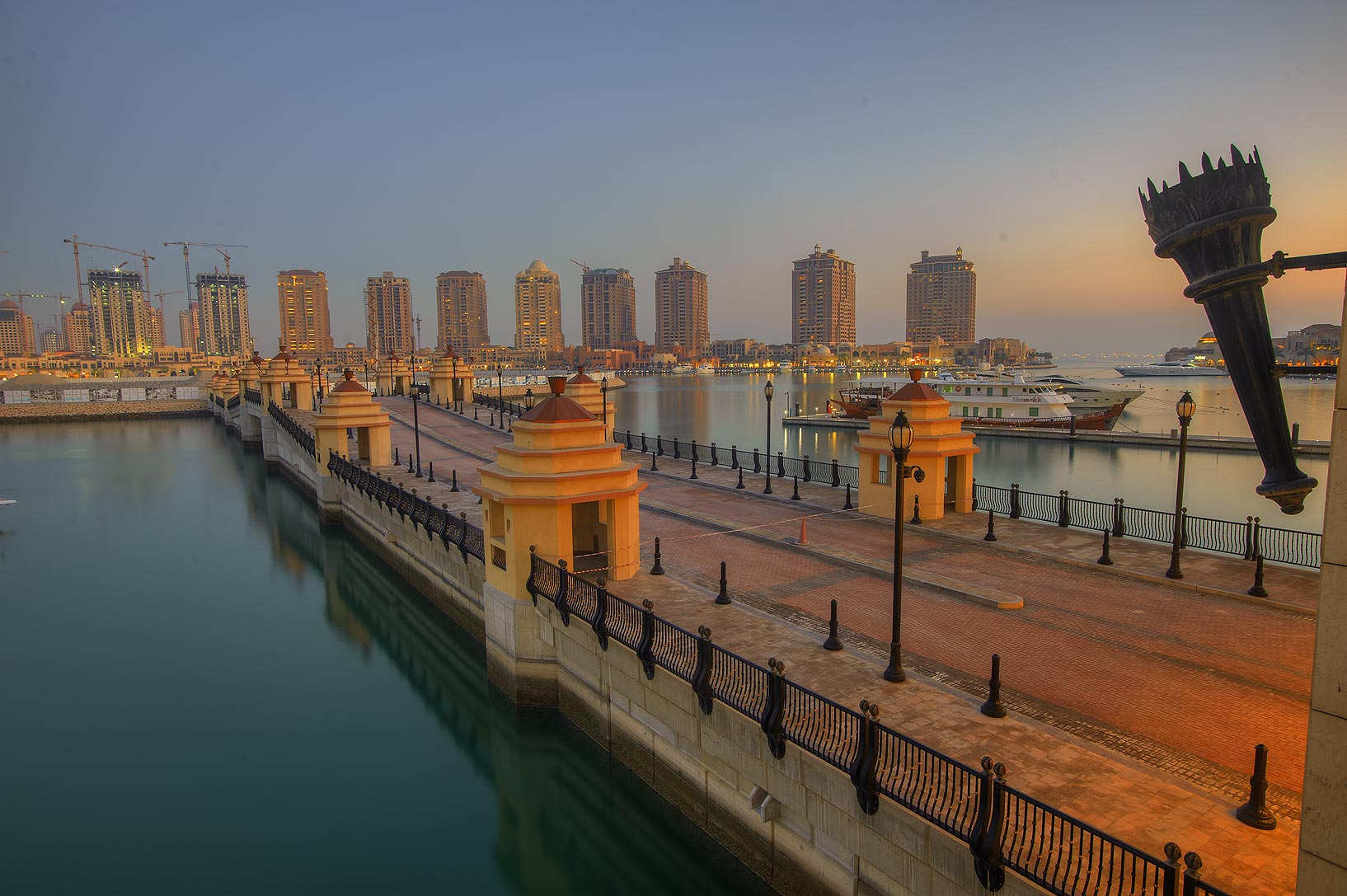 Sunset over Pier E in Porto Arabia in the Pearl Qatar development. Doha, Qatar
