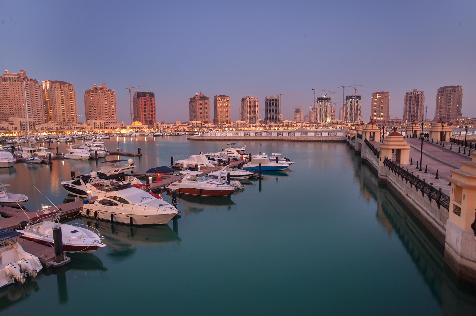 Dusk over Pier E in Porto Arabia in the Pearl Qatar development. Doha, Qatar