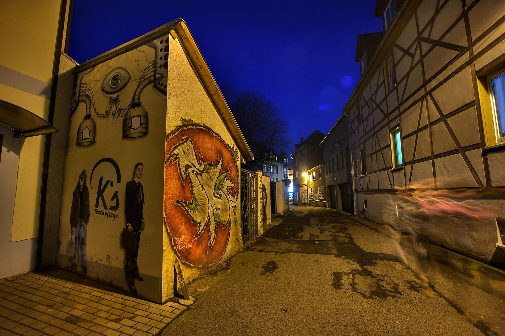 Street corner with graffiti in old city. Gotha, Germany