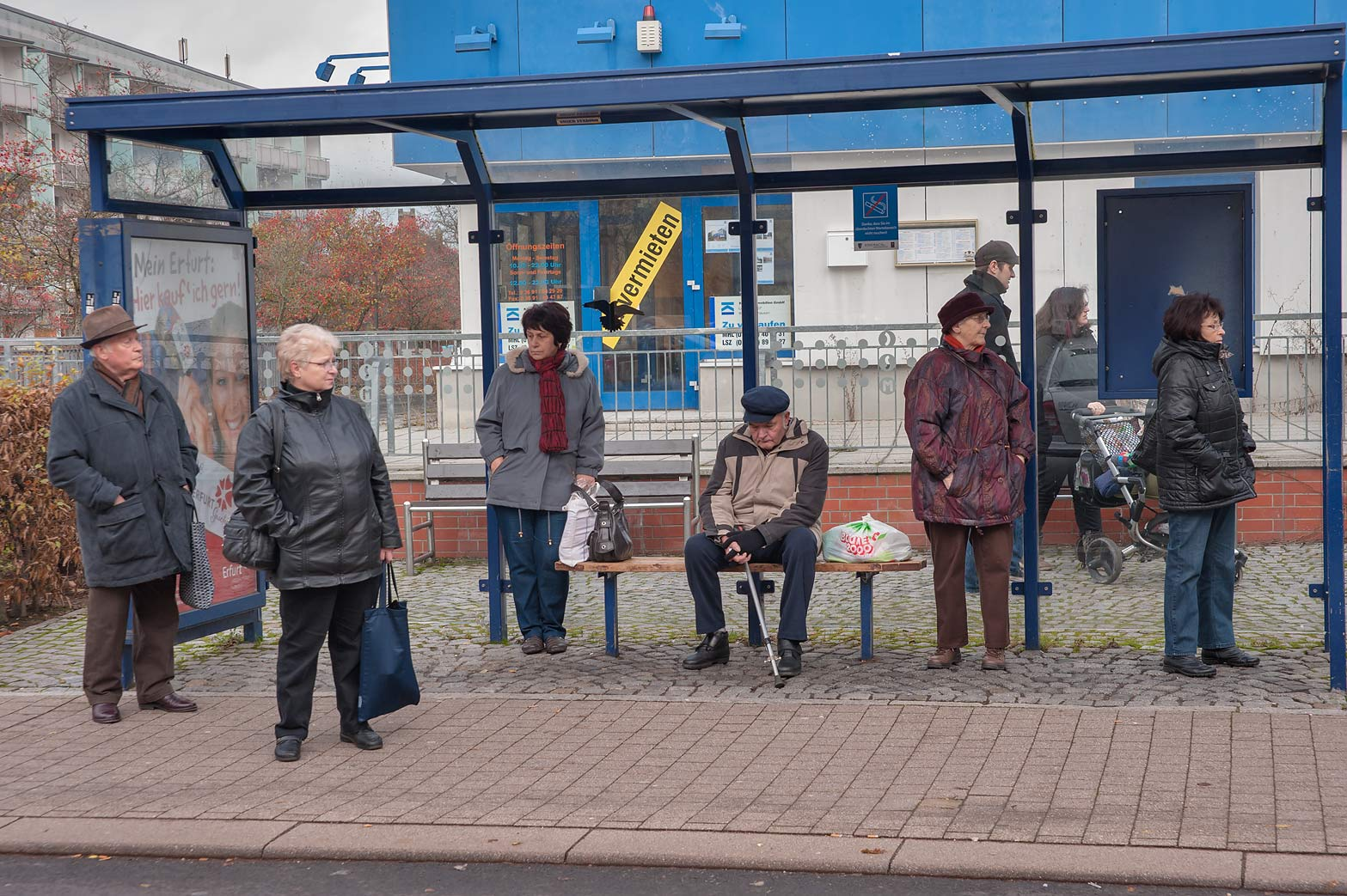 Passengers waiting on a bus stop. Eisenach, Germany