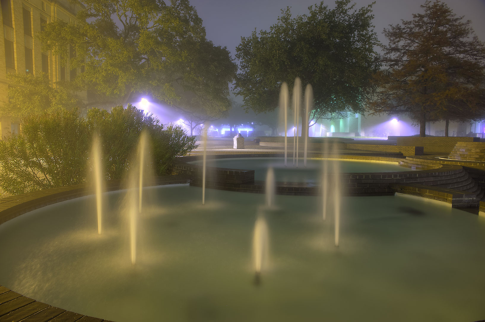 H2O Fountain in fog in front of Chemistry...M University. College Station, Texas