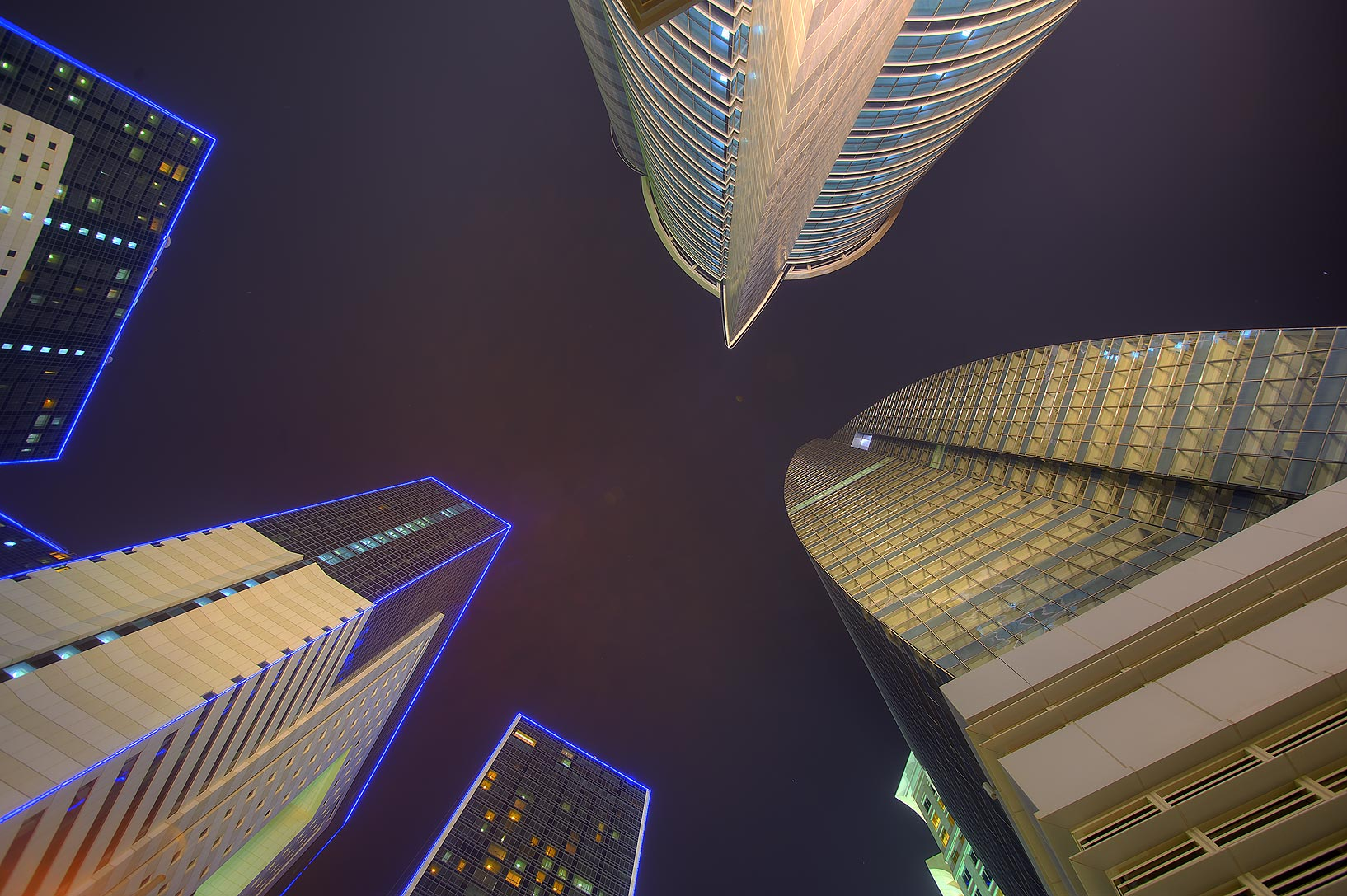 Empty towers and Ezdan Hotel at Al Betra St. in West Bay, looking up. Doha, Qatar
