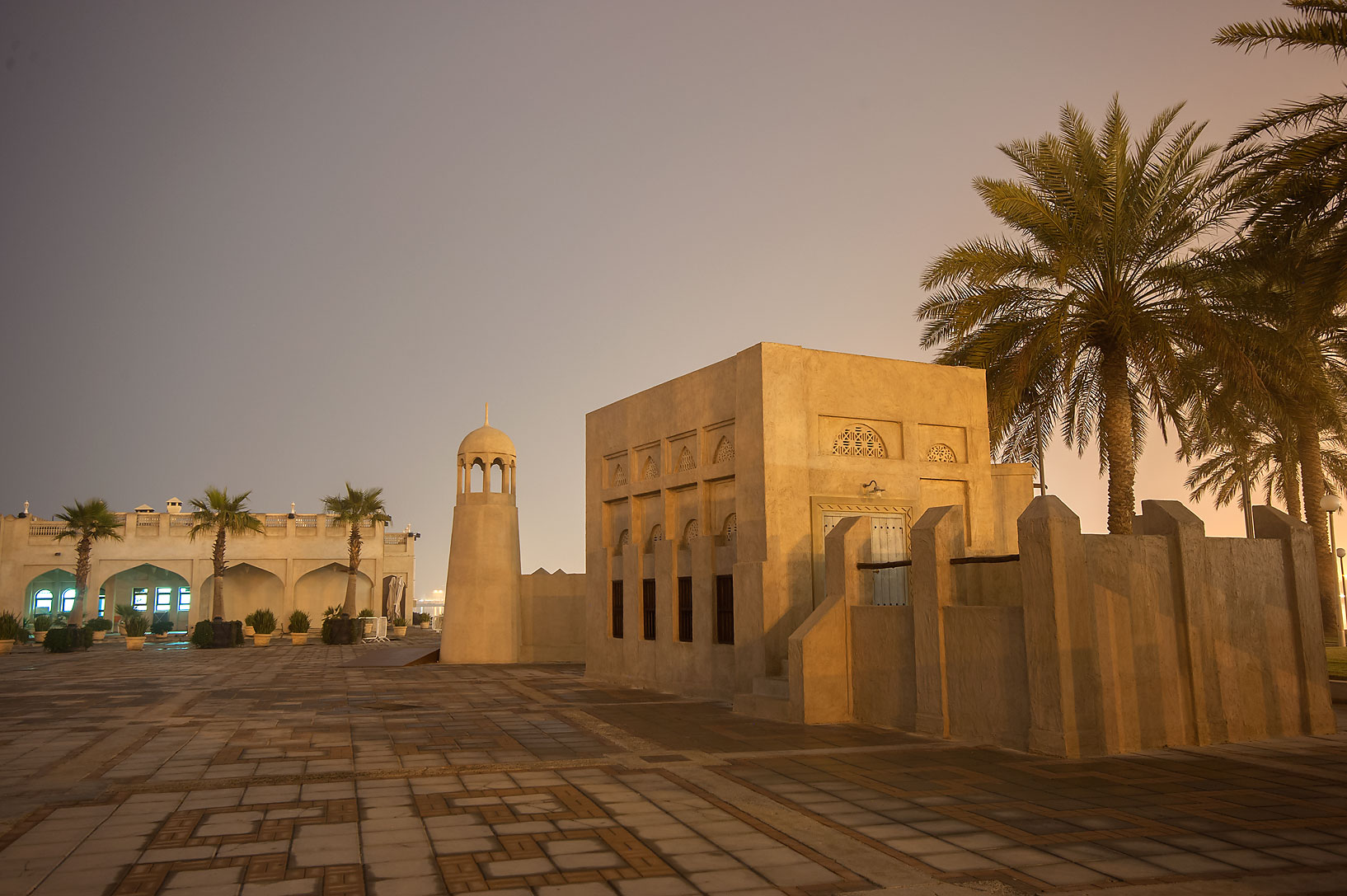 Recently built historical village with a fake...on Corniche Promenade. Doha, Qatar