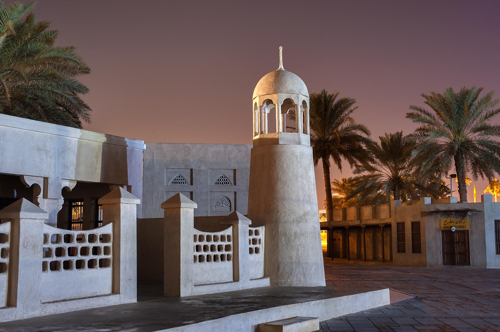Minaret of a reconstructed historical mosque near...on Corniche Promenade. Doha, Qatar