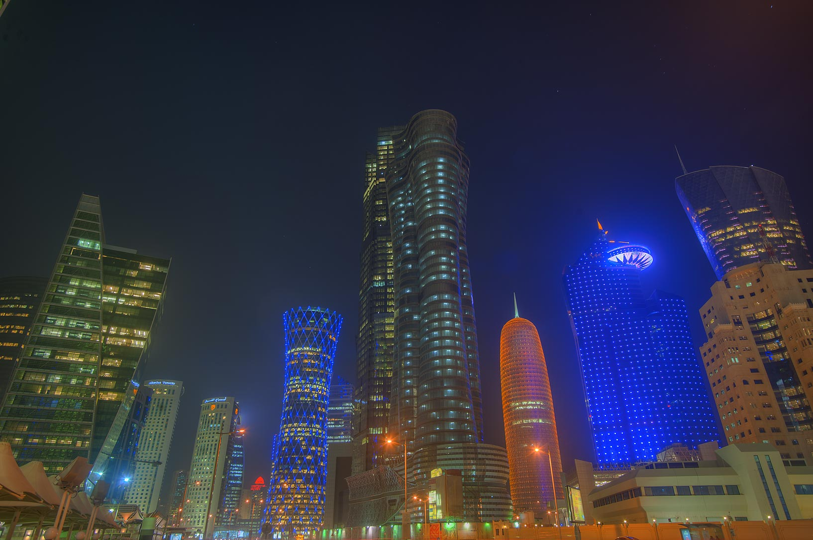 Majlis Al Taawon St. in West Bay at evening. Doha, Qatar
