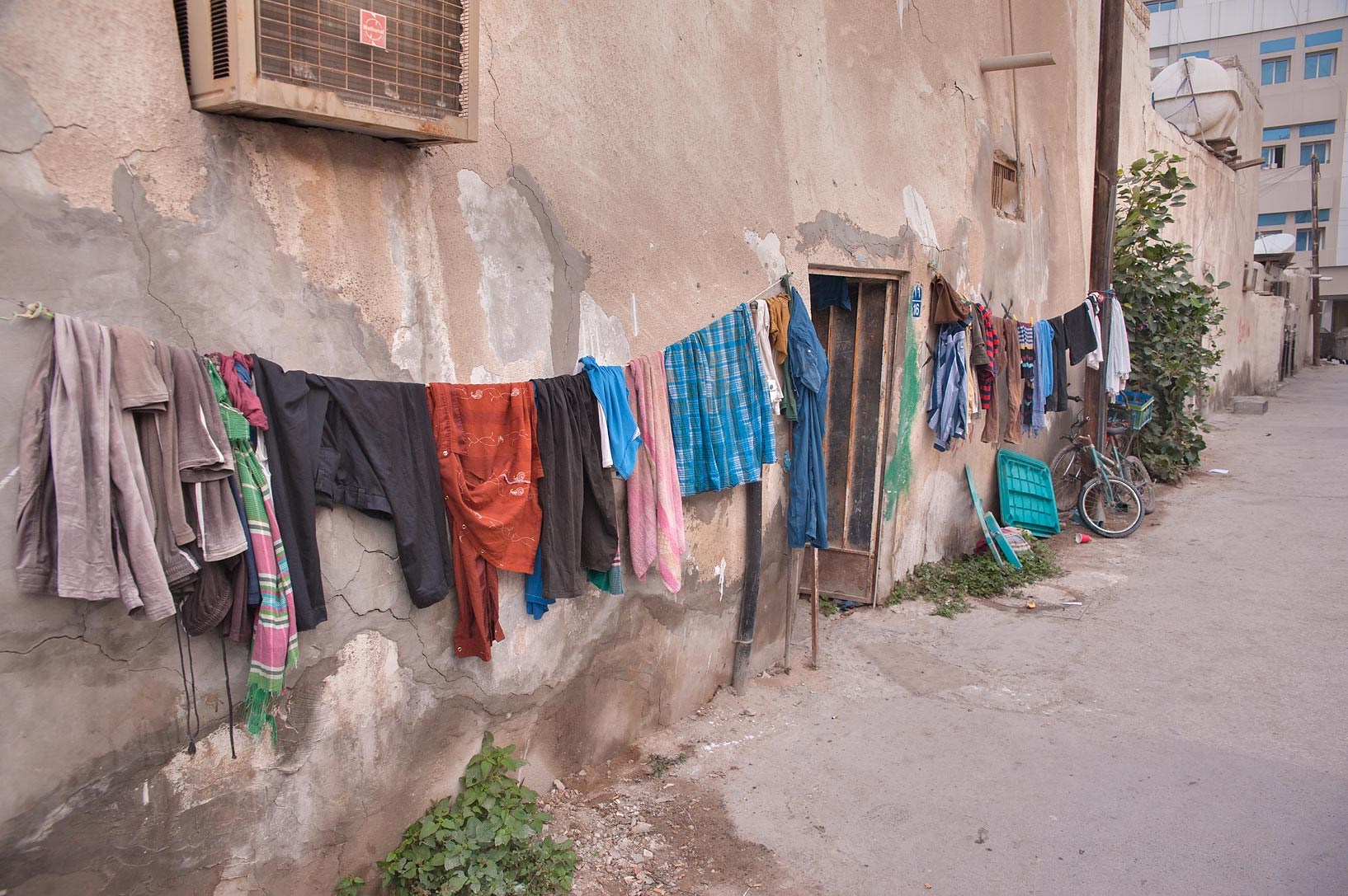 Hanging laundry on Umm Wishad St. in Musheirib neighborhood. Doha, Qatar