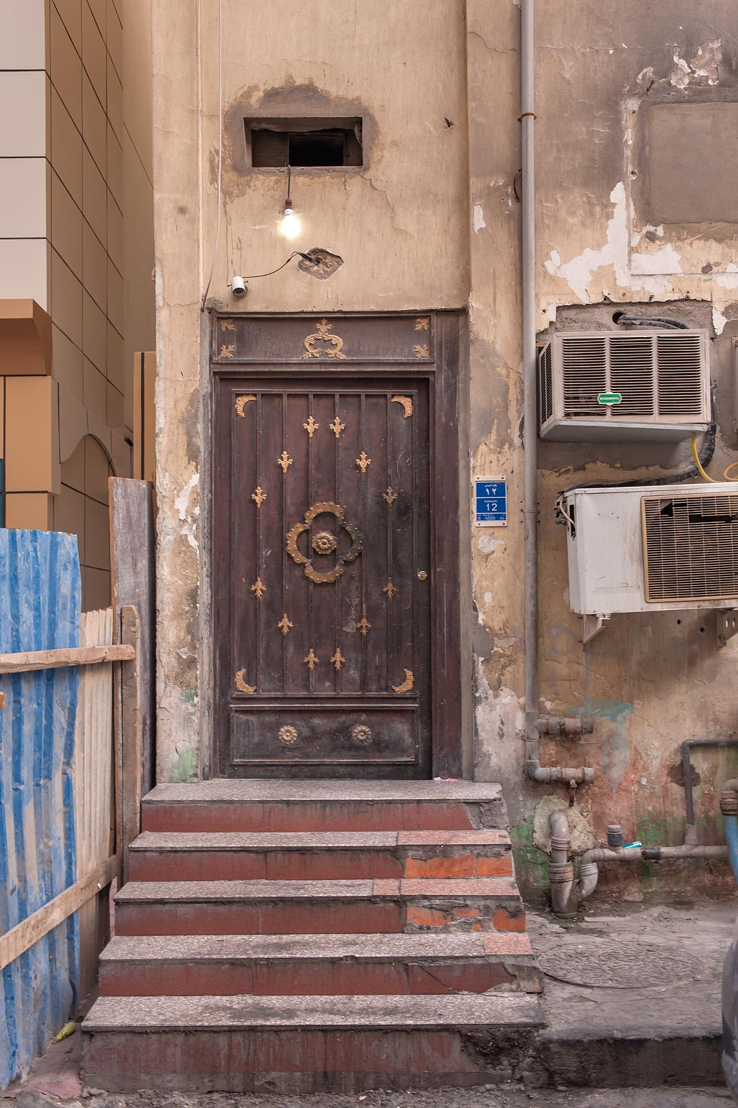 Iron door at Ziyad Bin Eyad St. in Al Doha Al Jadeeda neighborhood. Doha, Qatar